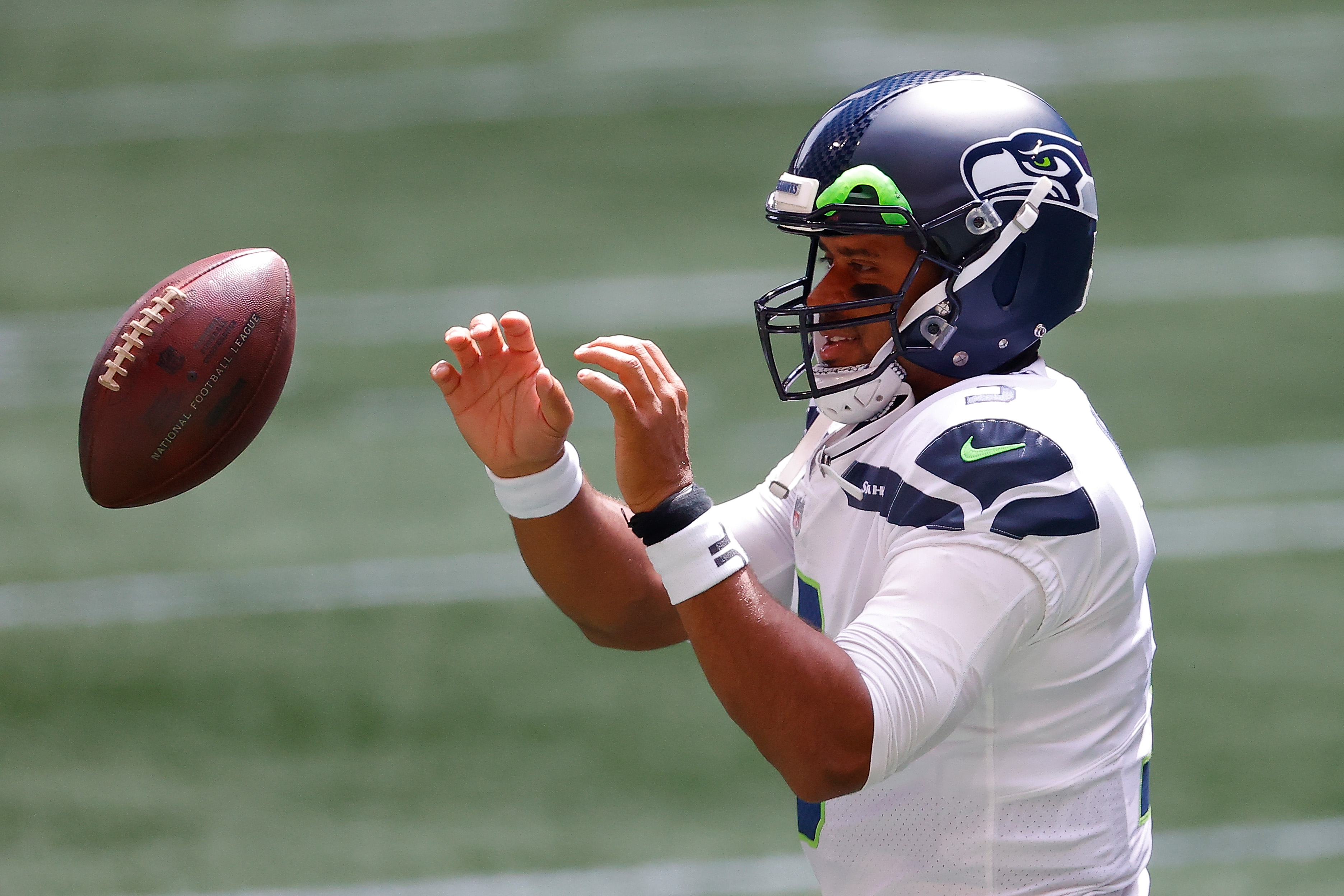 Russell Wilson names the Seattle Seahawks starting five basketball team.
