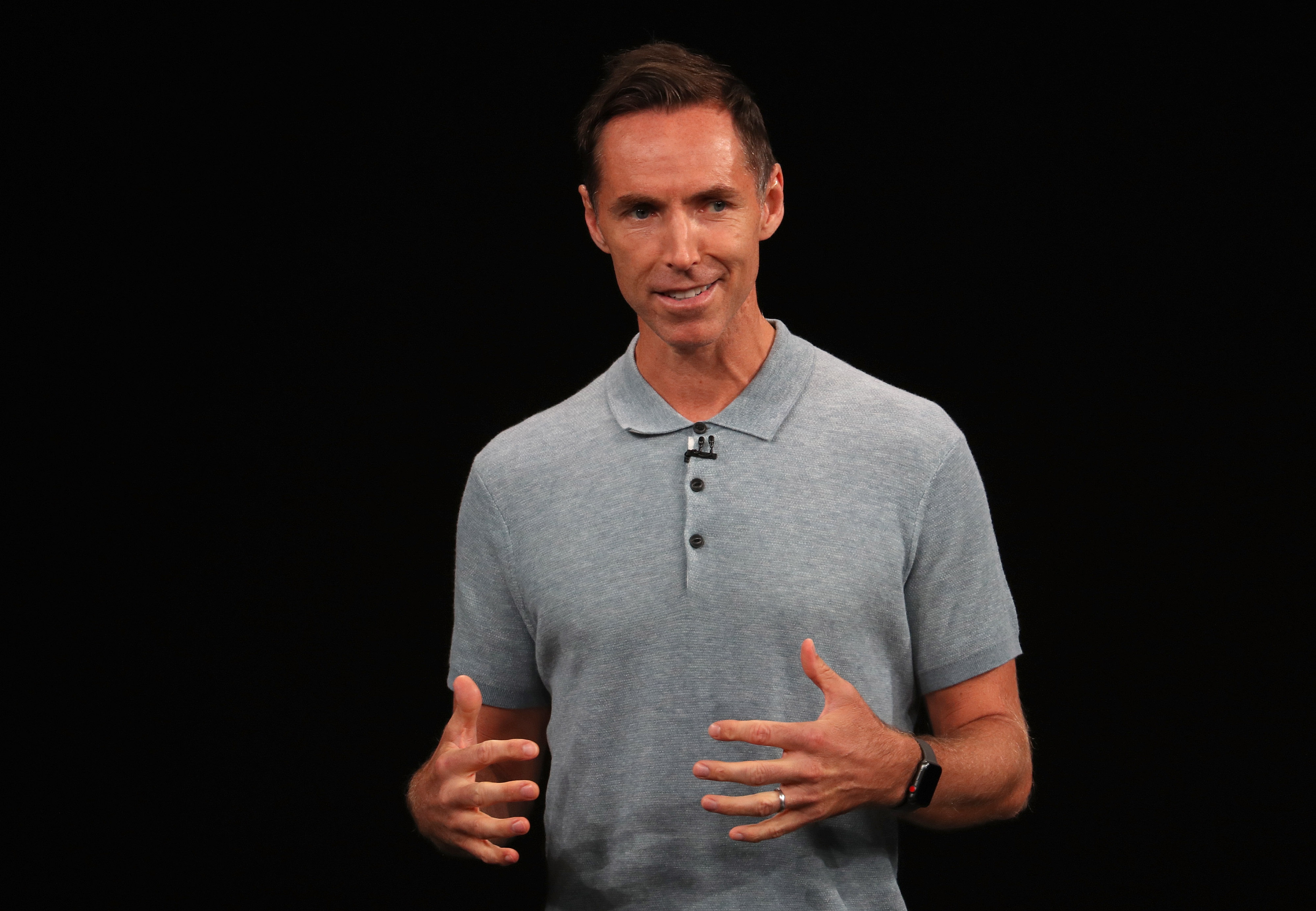 Steve Nash talking to the crowd at an Apple event