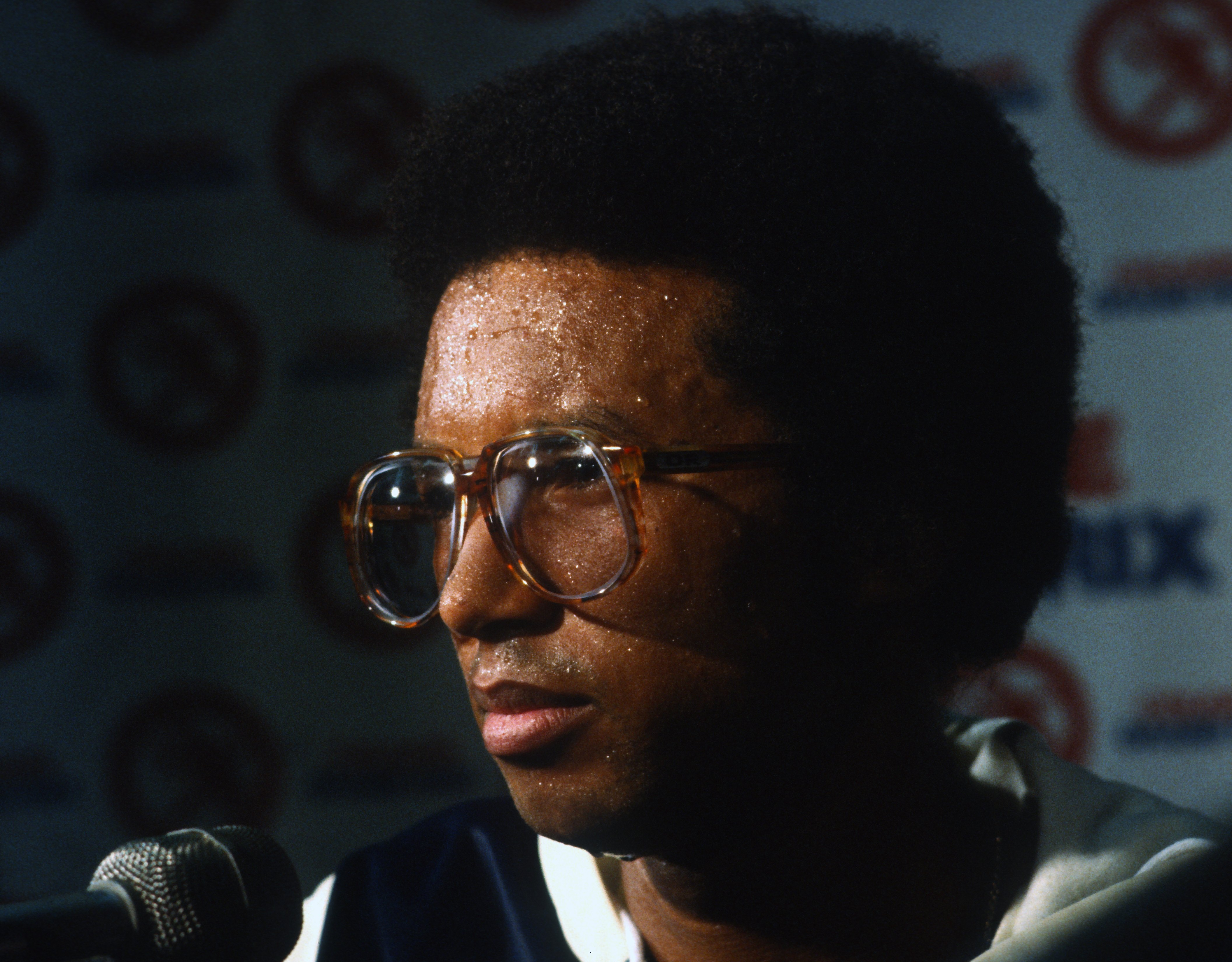 Tennis player Arthur Ashe at a press conference in 1979
