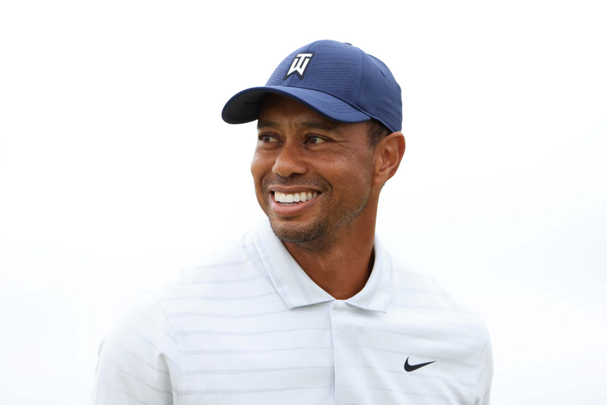 Tiger Woods smiles while playing in a golf event