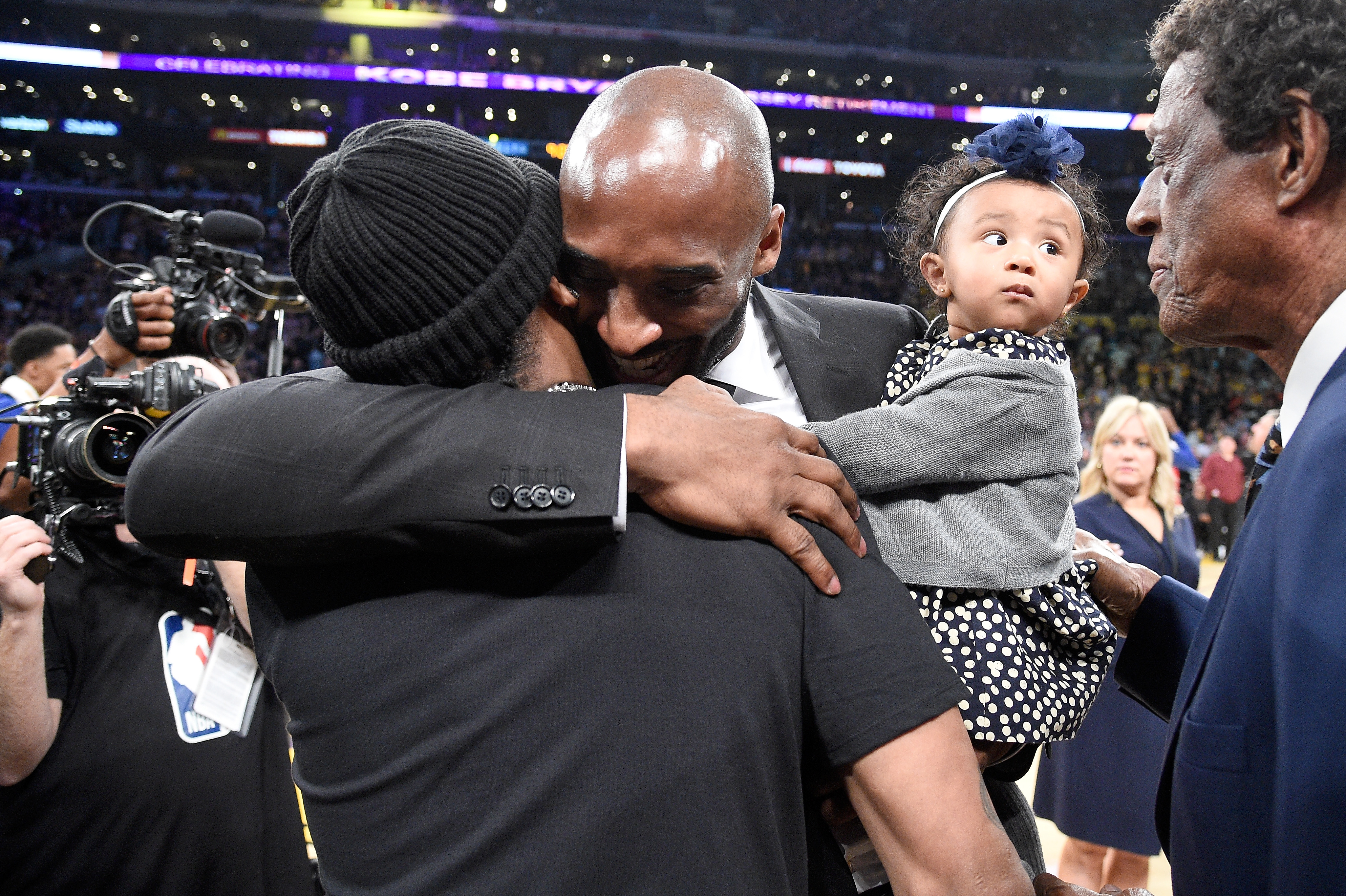 Allen Iverson and Kobe Bryant hug in 2017