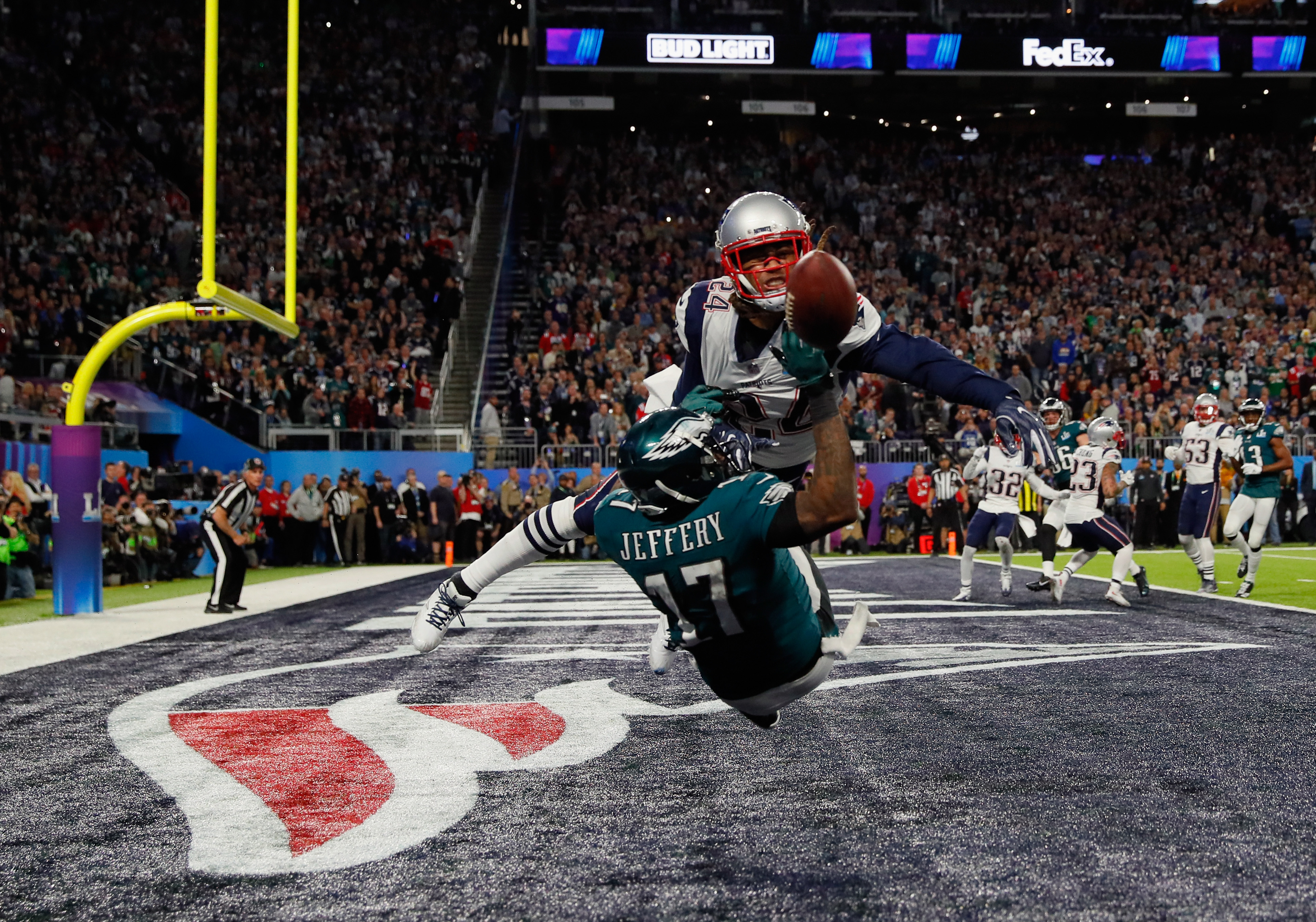 Alshon Jeffery of the Philadelphia Eagles misses the pass attempt under pressure from Stephon Gilmore of the New England Patriots in 2018