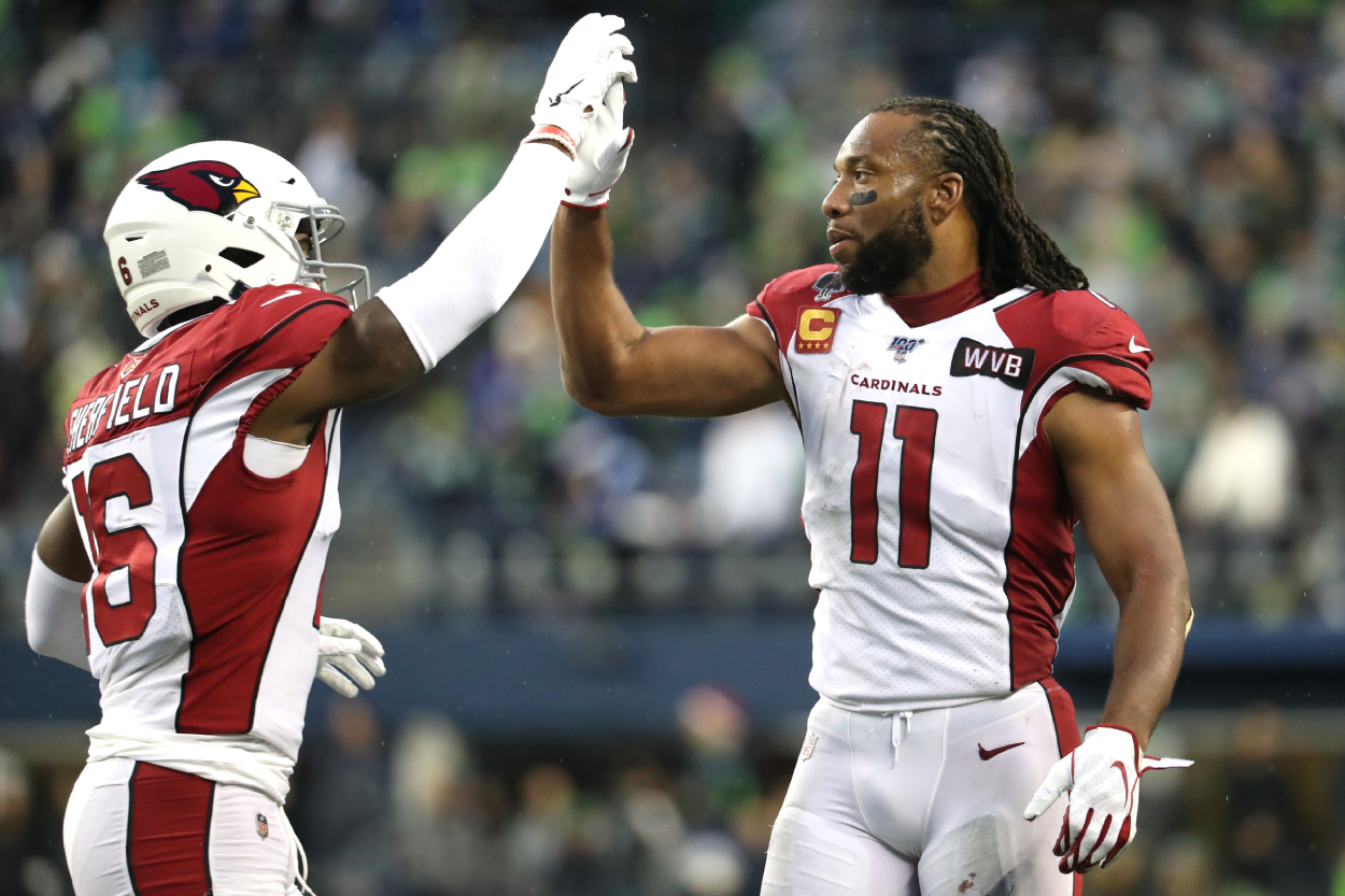 Larry Fitzgerald high fives his teammate Trent Sherfield