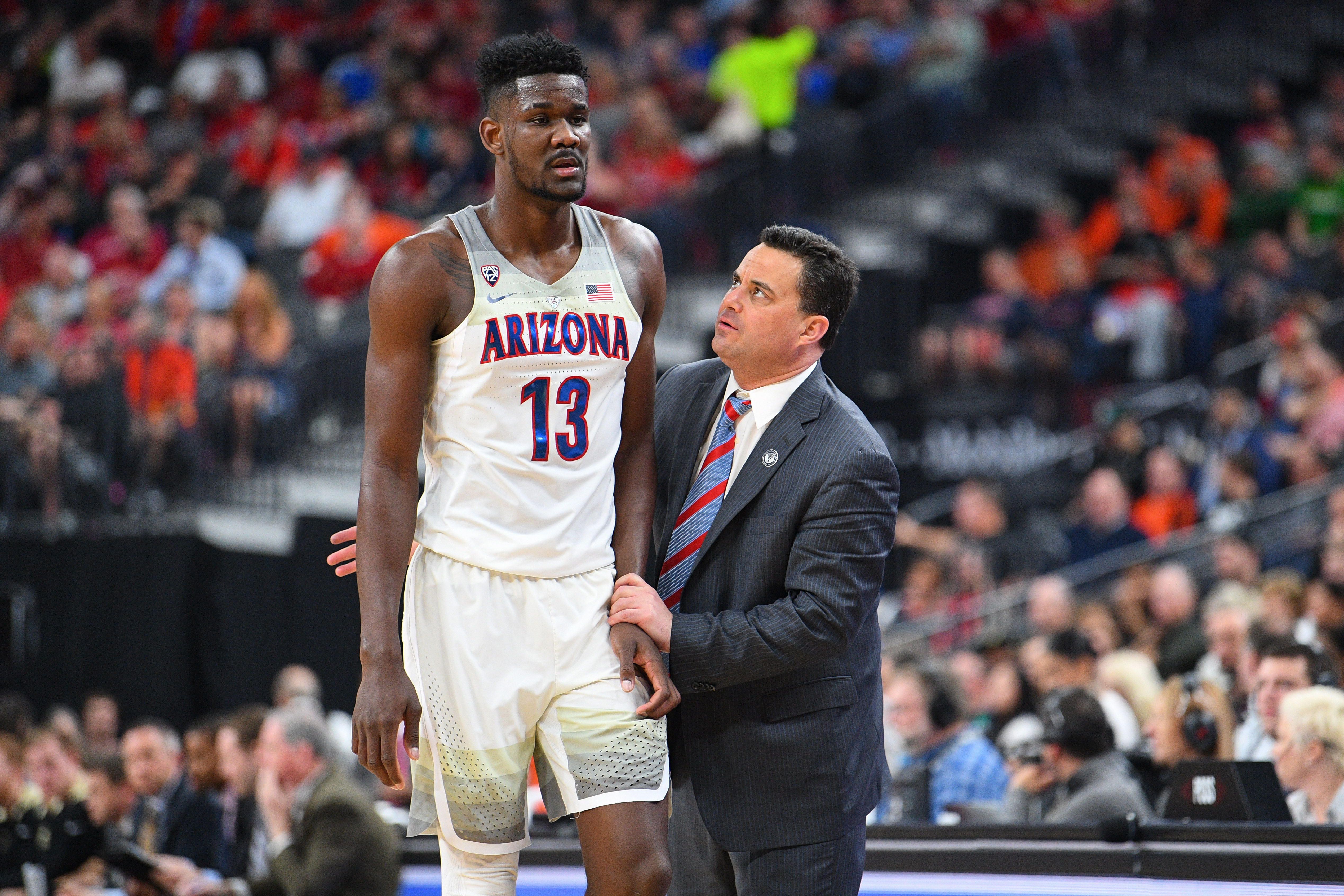 Arizona forward Deandre Ayton is instructed by head coach Sean Miller
