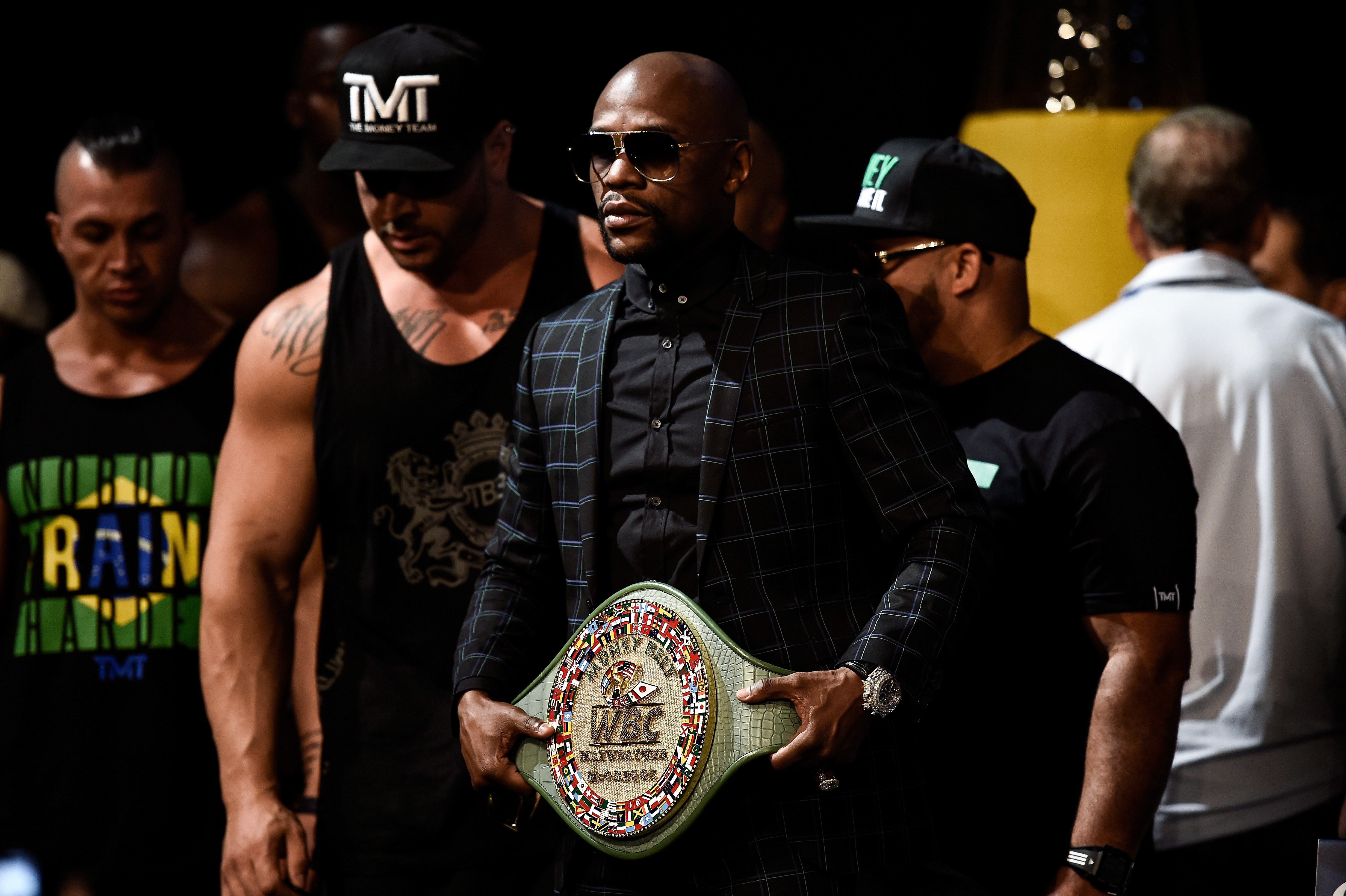 Boxer Floyd Mayweather Jr. poses with the Money Belt in 2017