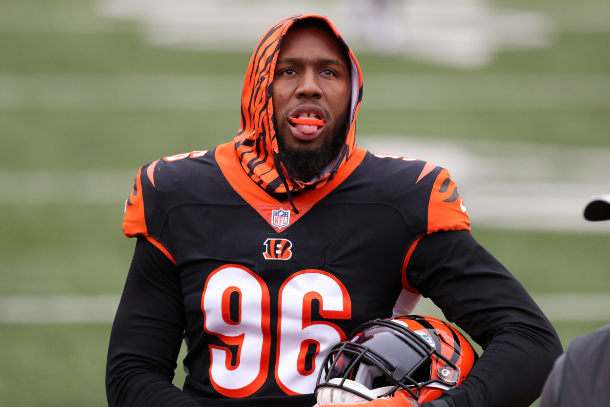 Carlos Dunlap looks on from the sideline during a Bengals game