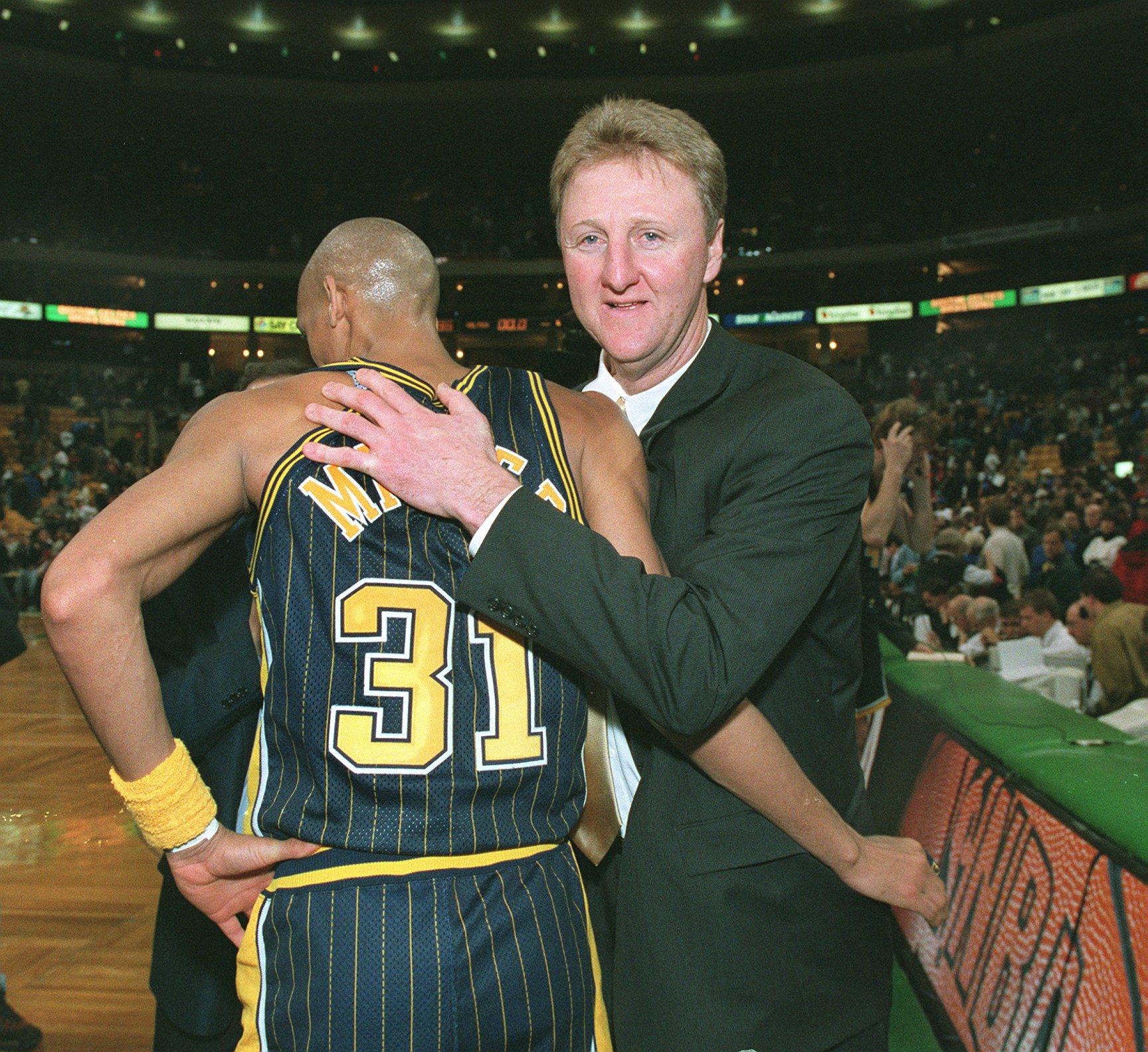 Larry Bird's greets Reggie Miller