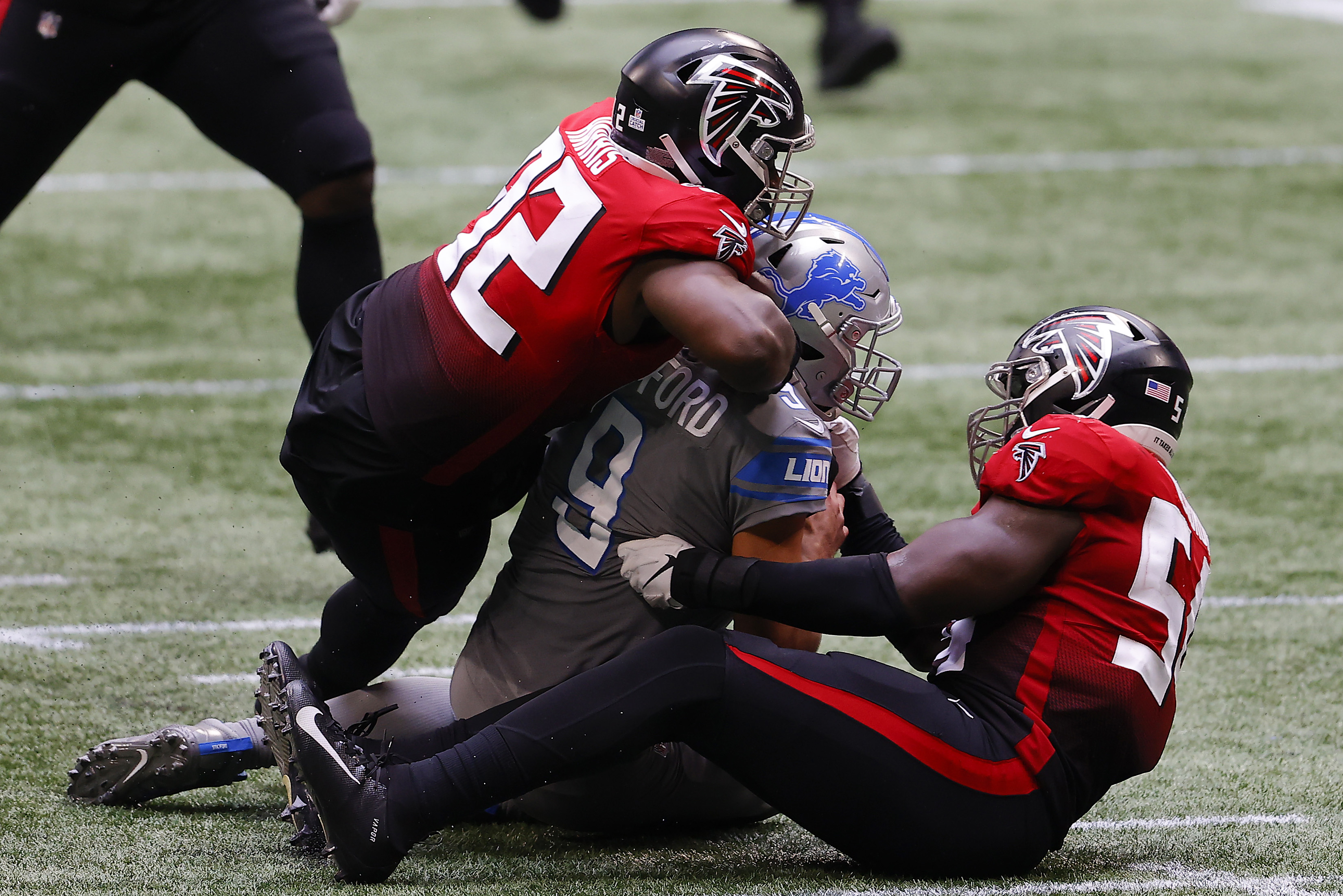Matthew Stafford of the Detroit Lions is tackled by Charles Harris of the Atlanta Falcons
