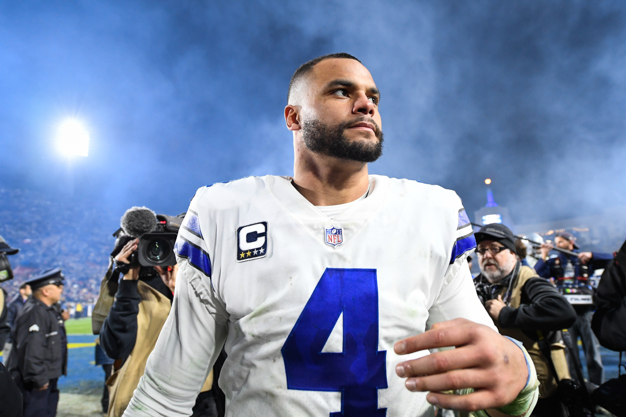 Dak Prescott walks off the field after a game