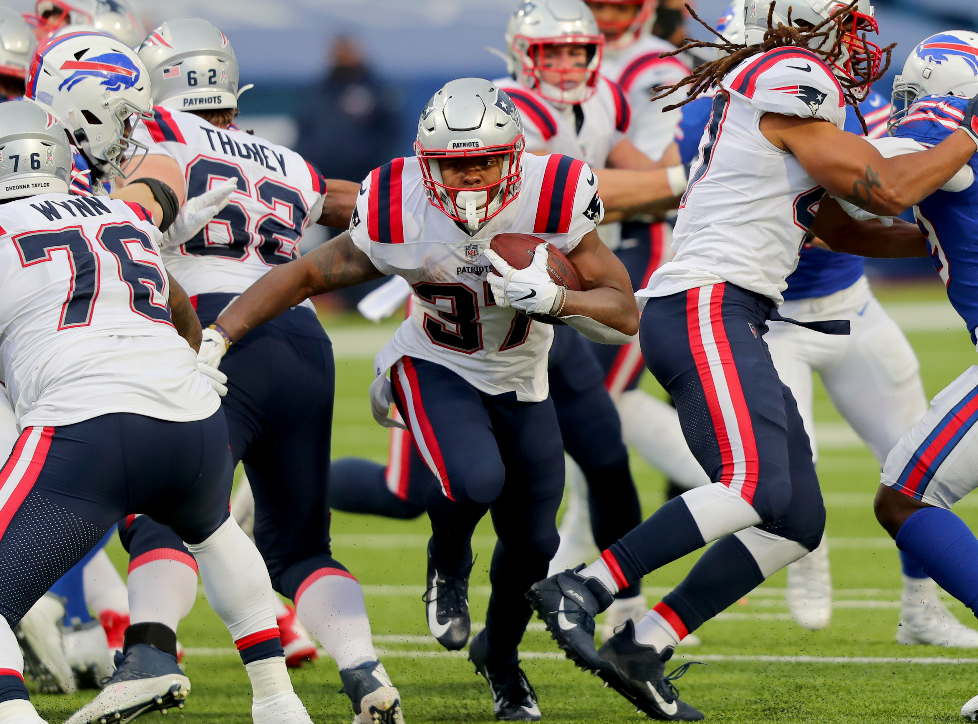 Damien Harris of the New England Patriots runs the ball
