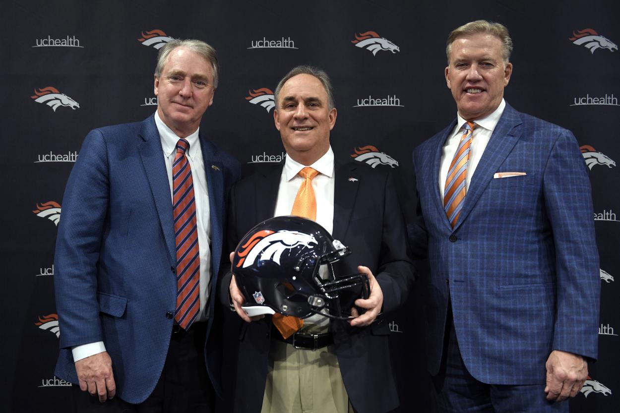 Denver Broncos CEO Joe Ellis, Head Coach Vic Fangio, General Manager John Elway pose for a photo