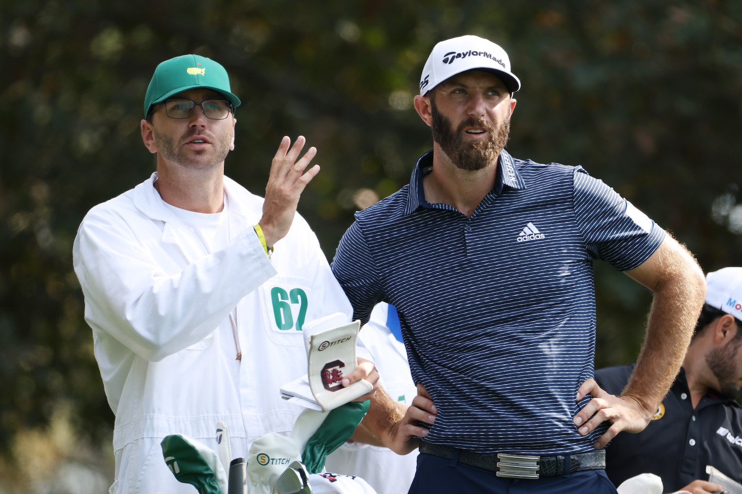 Dustin Johnson stands with caddie Austin Johnson
