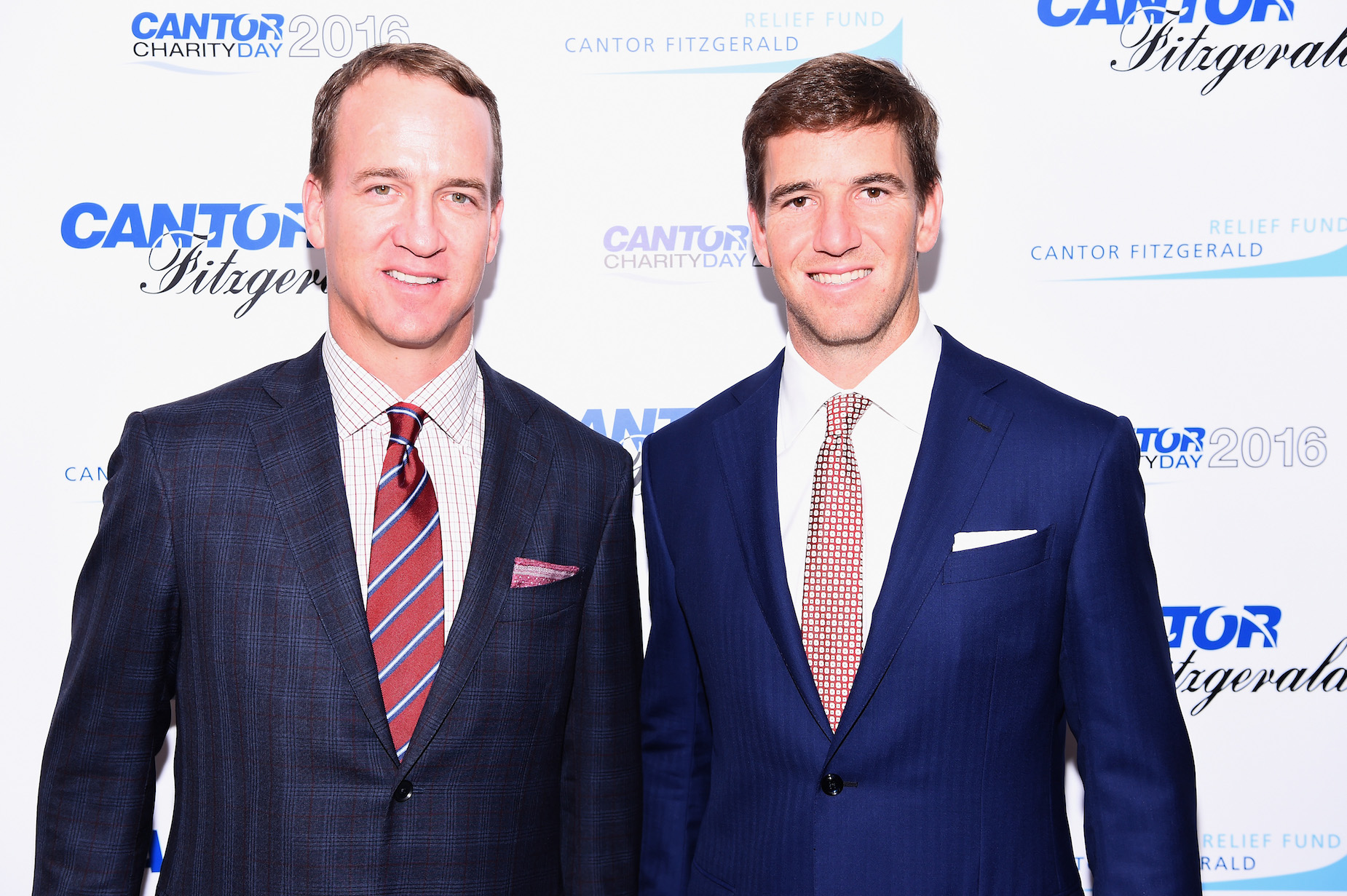 What is Eli Manning's net worth and how does it compare to Peyton Manning's?