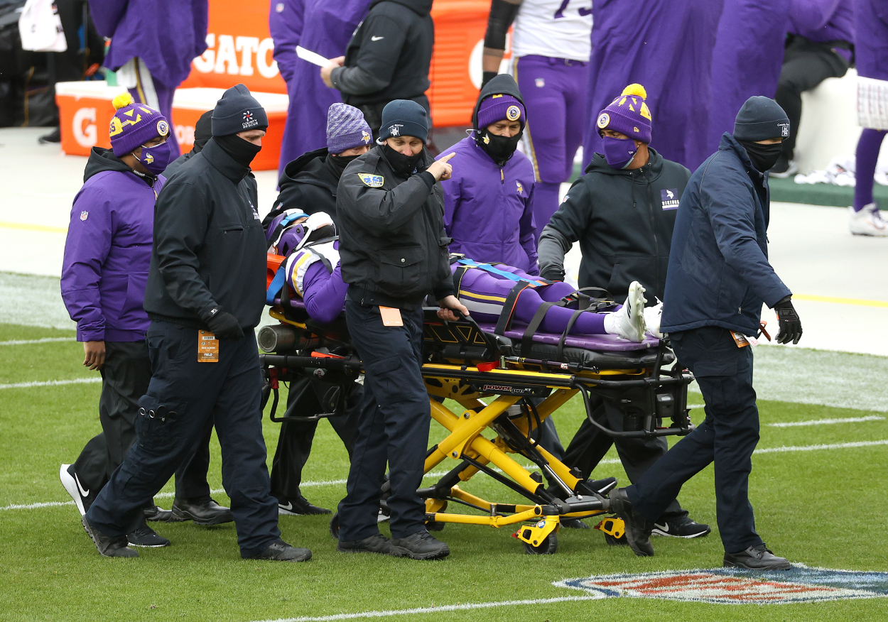 A Minnesota Vikings player is taken off the field in a stretcher after a neck injury