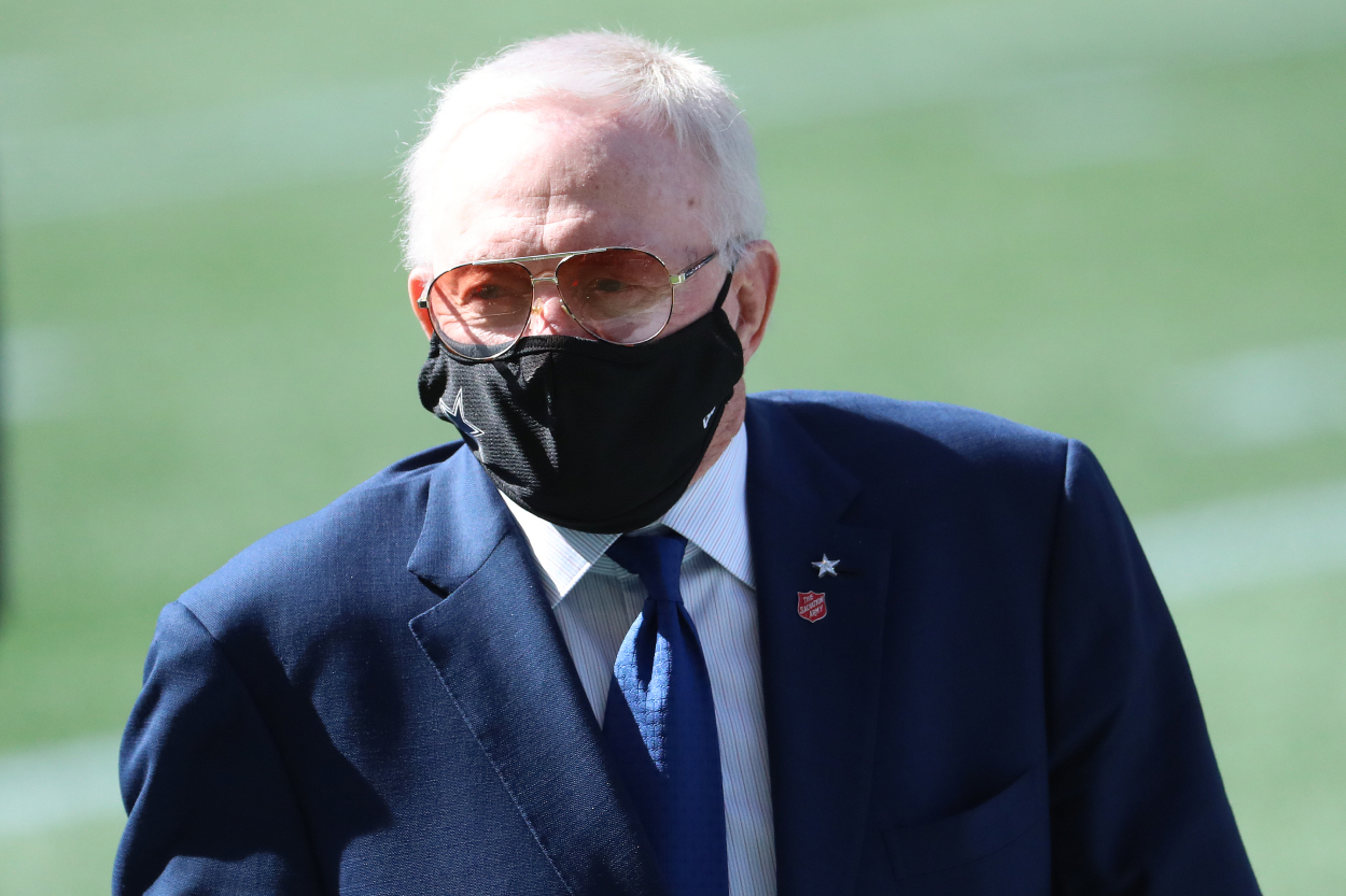 Jerry Jones watching a Cowboys game with a mask on