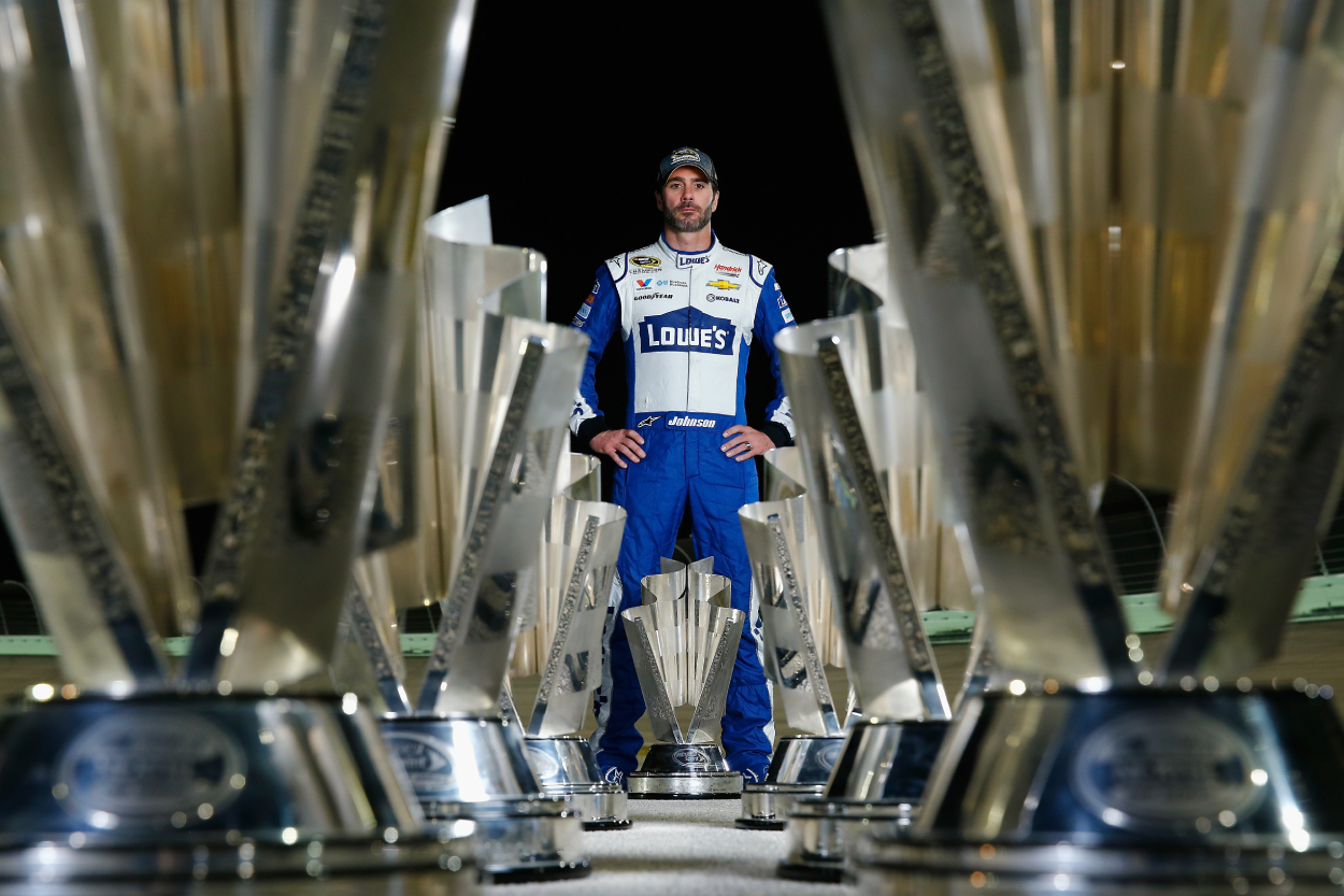 Jimmie Johnson poses for a photo after winning a race