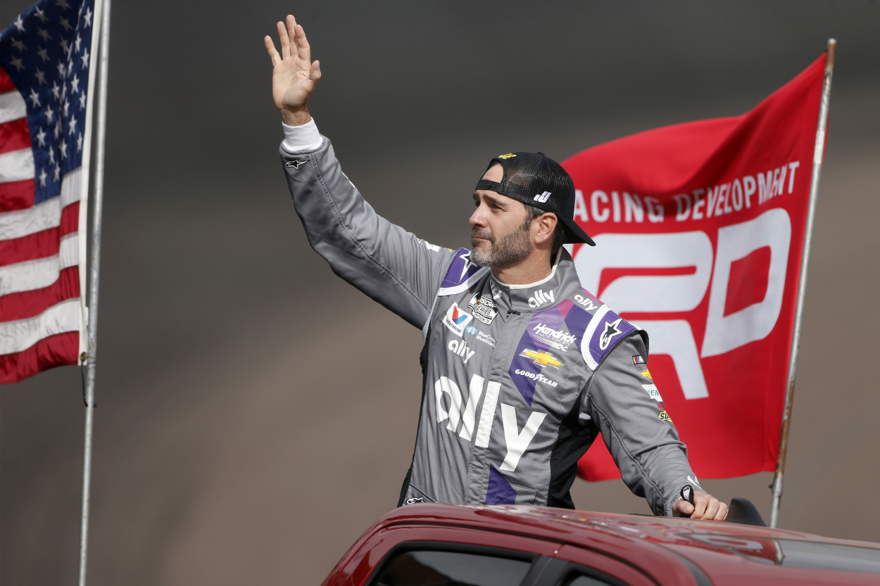 Jimmie Johnsons waves to NASCAR fans after a race