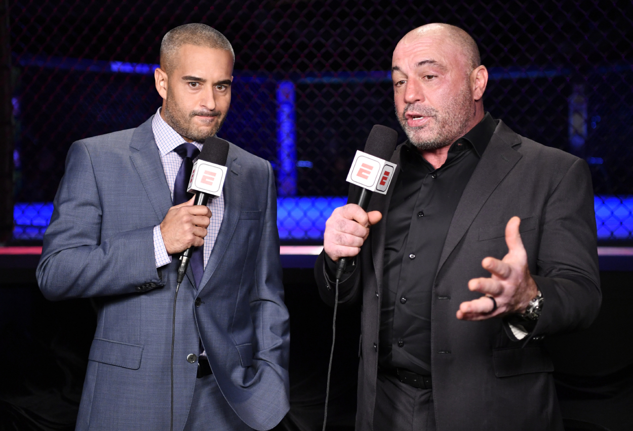 Joe Rogan and Jon Anik talking at a UFC event