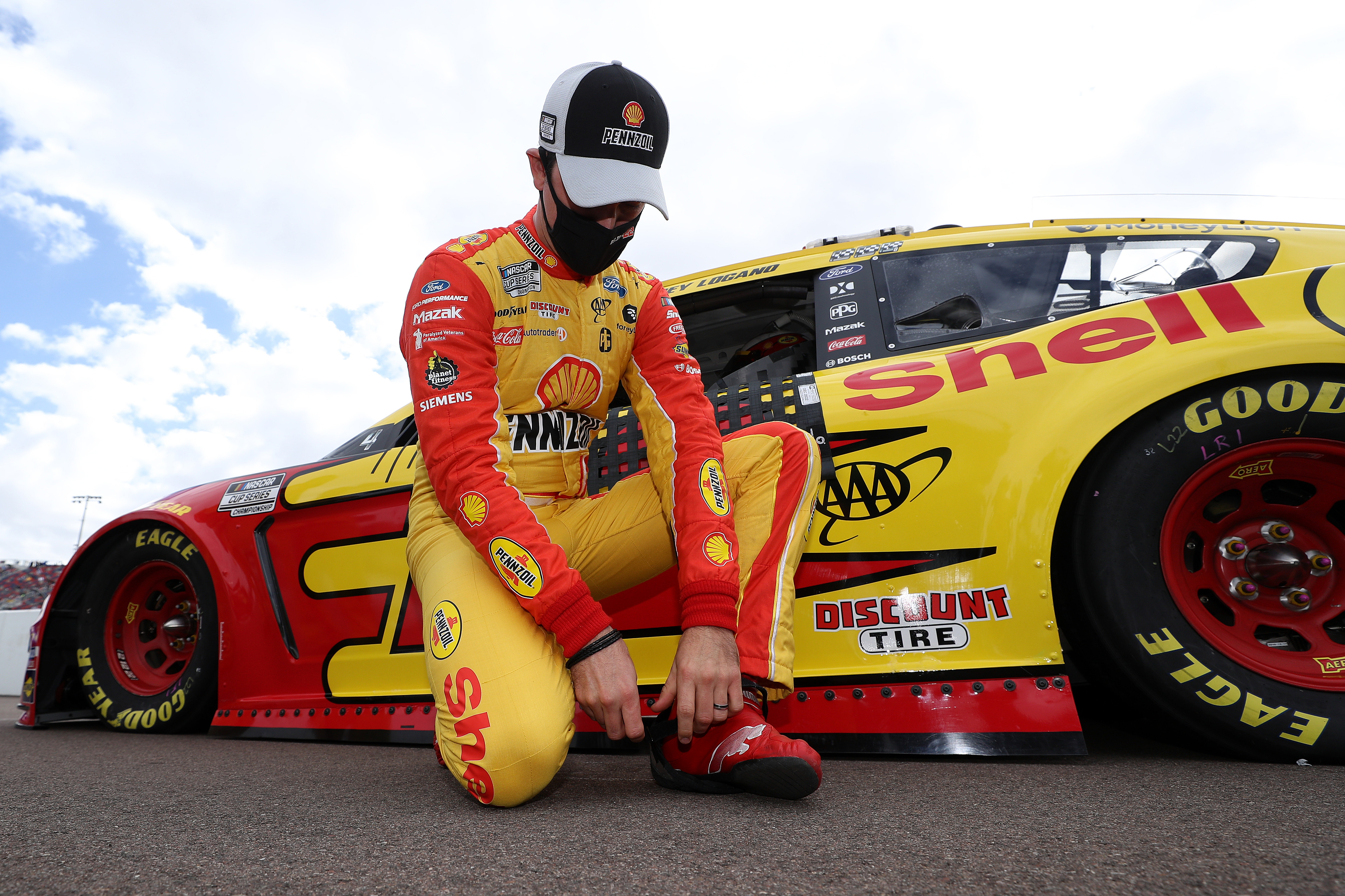 Joey Logano, driver of the #22 Shell Pennzoil Ford, waits on the grid