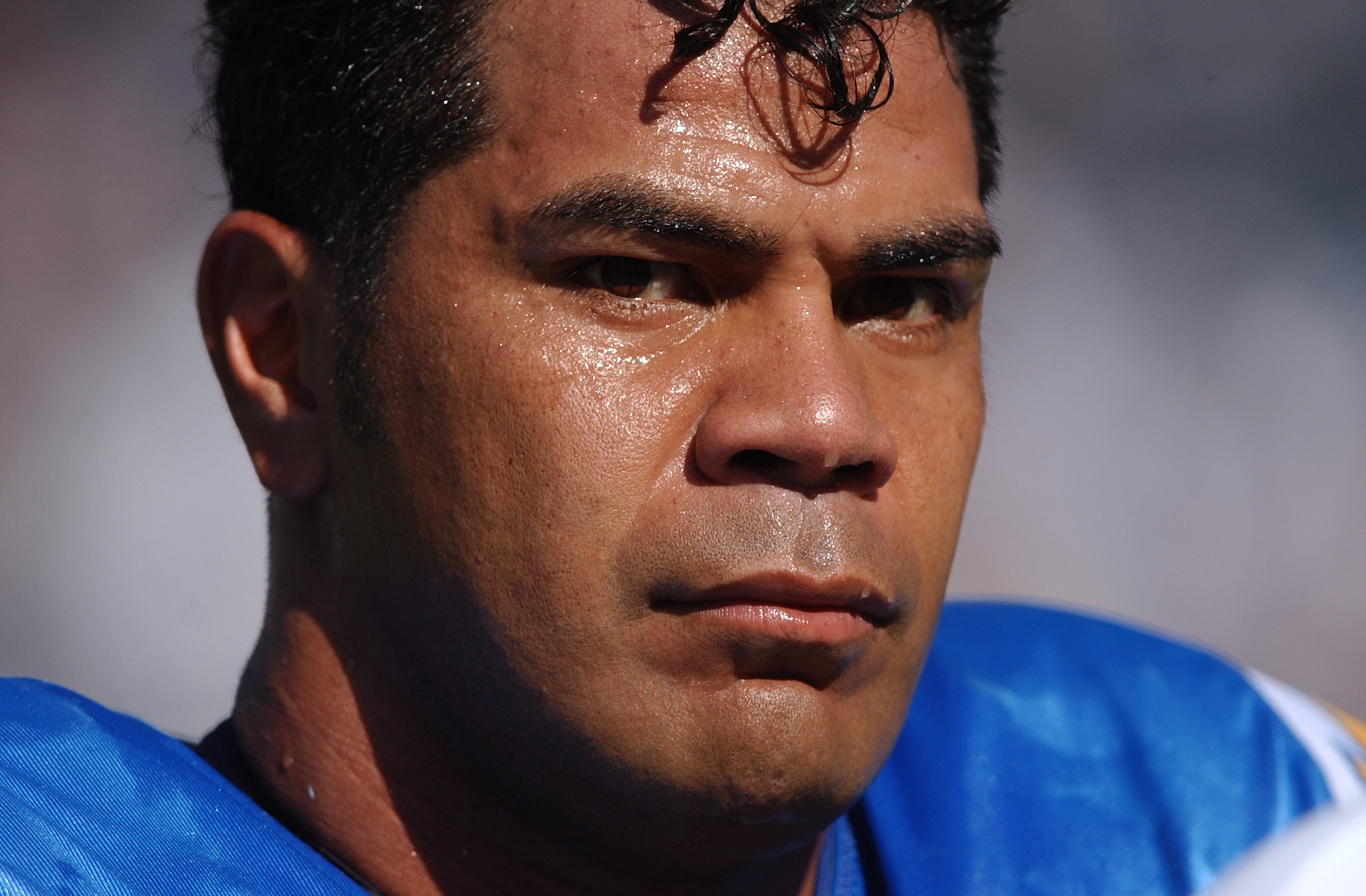 Junior Seau looks on during a Chargers game