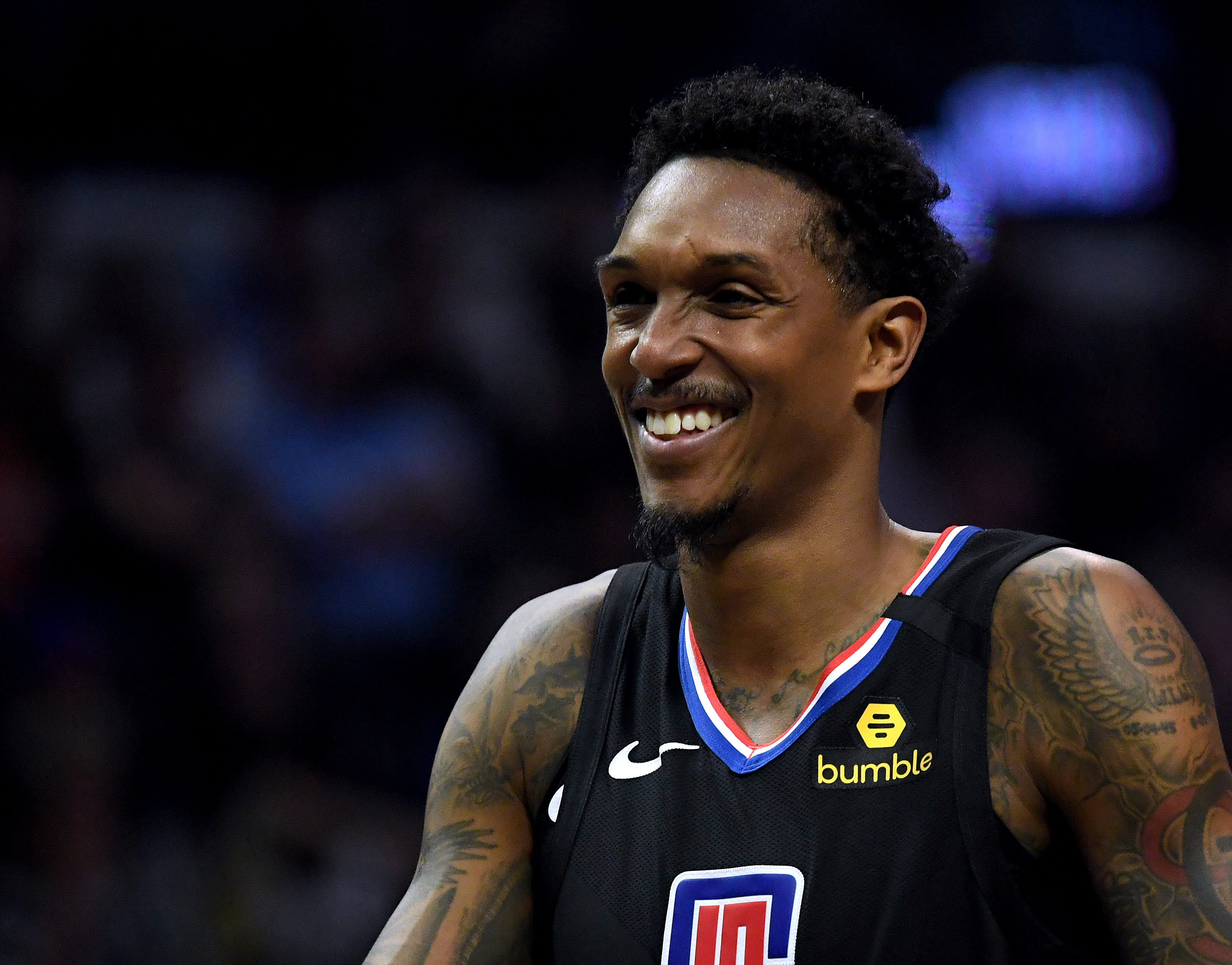 Lou Williams of the LA Clippers smiles during a timeout