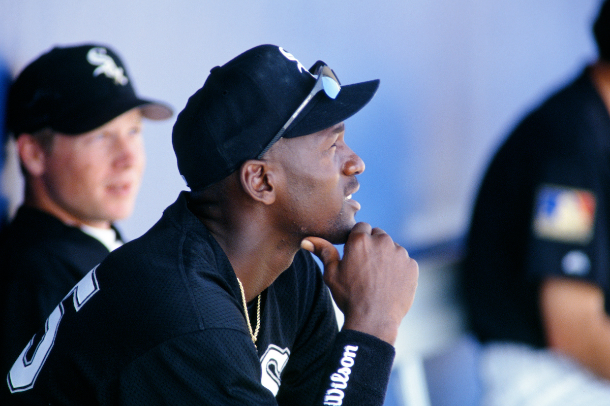 Michael Jordan of the Chicago White Sox looks on from the dugout