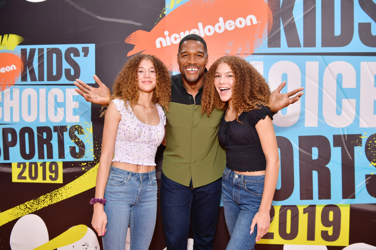 Michael Strahan and daughters Sophia and Isabella pose for a photo