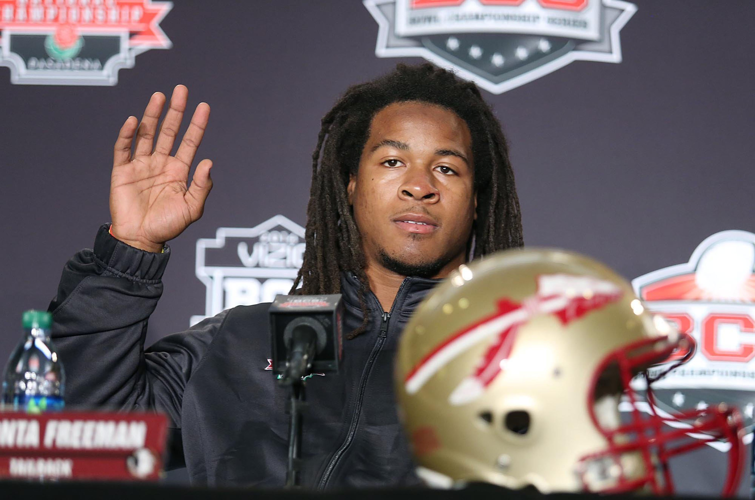 Running back Devonta Freeman waves during a BCS National Championship game news conference in 2014