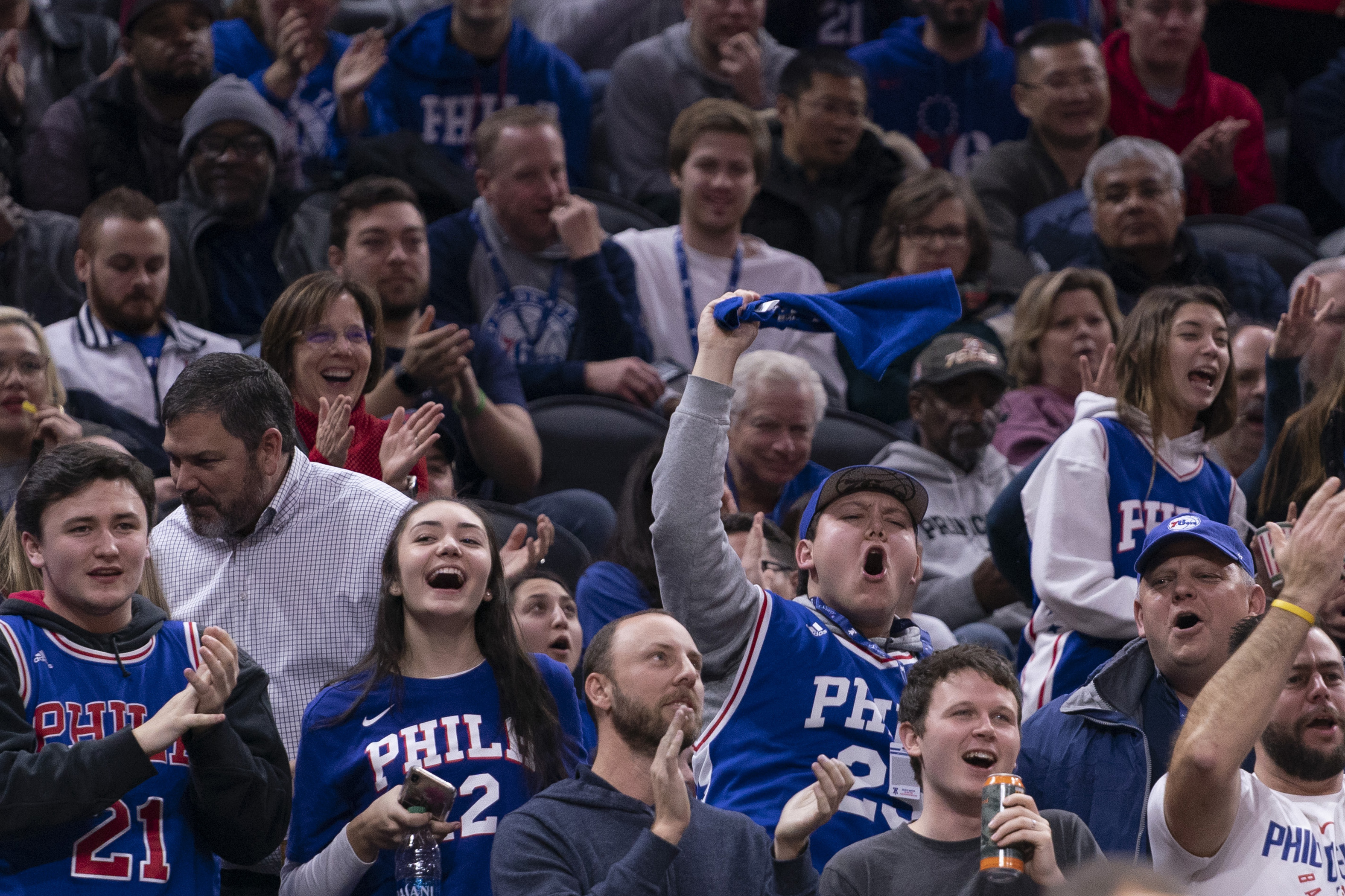 Philadelphia 76ers fans cheering on the team