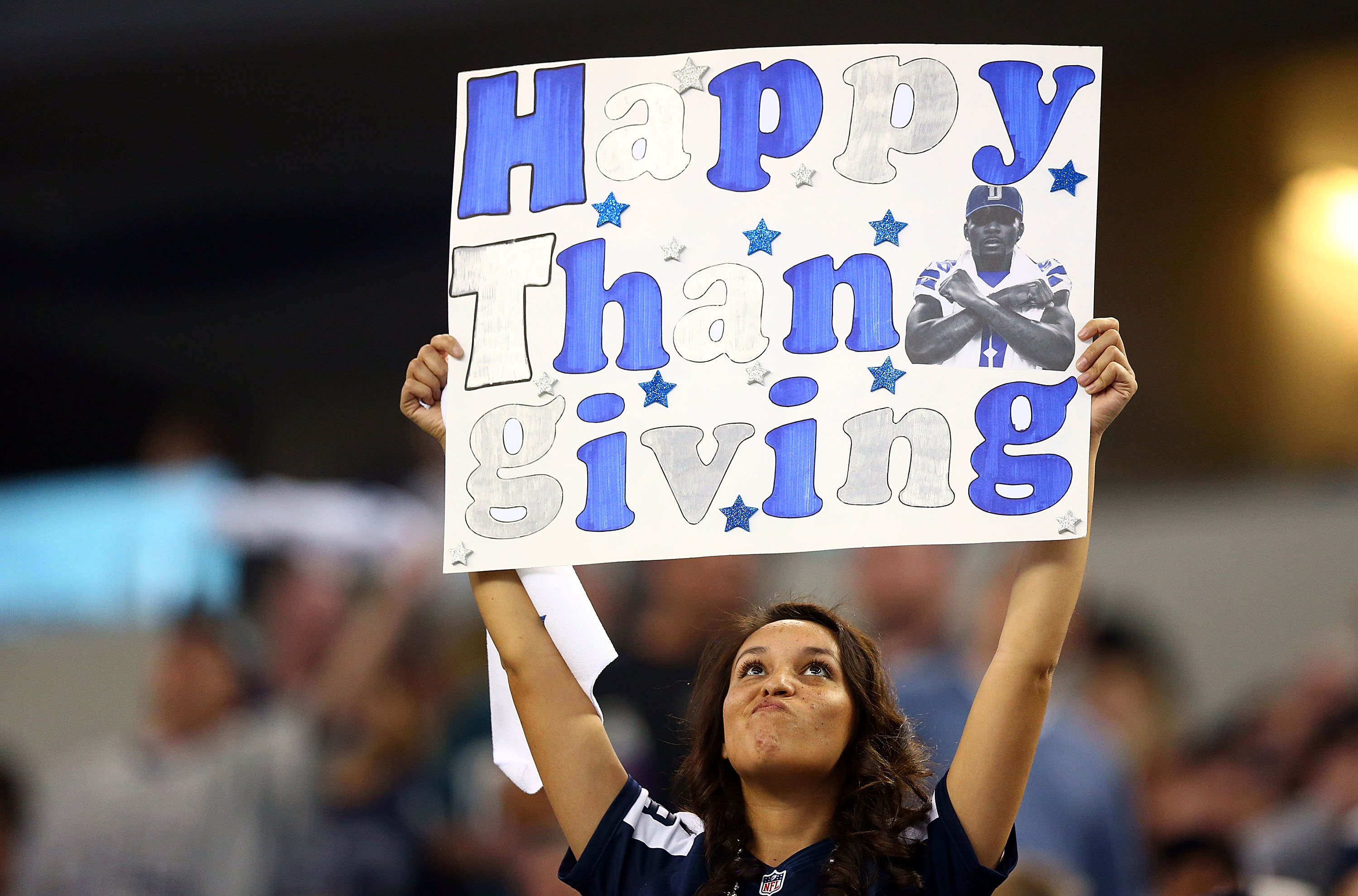 When did the NFL add a third team to the Thanksgiving Day menu?