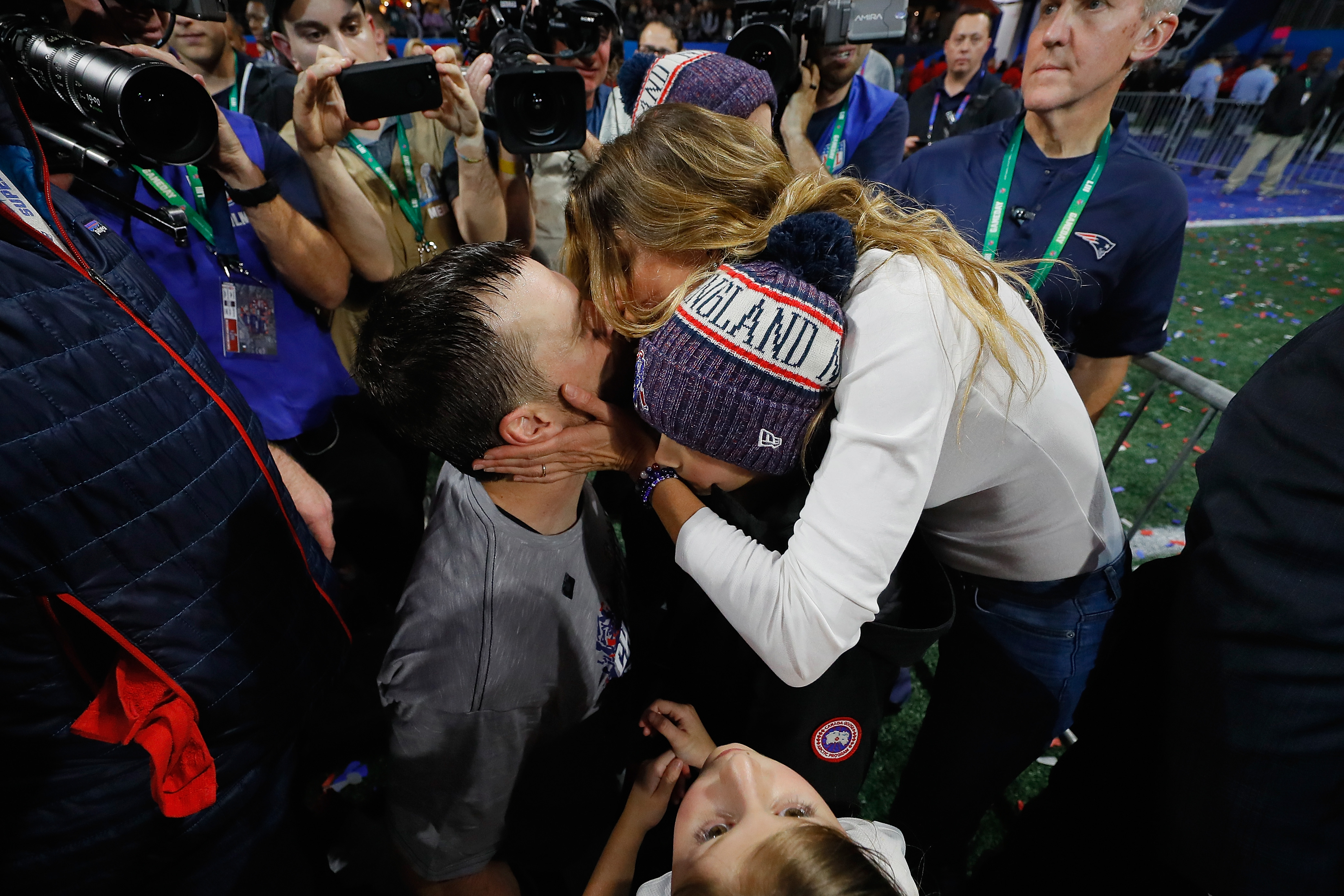 Super Bowl LIII - Tom Brady kisses his wife Gisele Bundchen after the Patriots win Sup