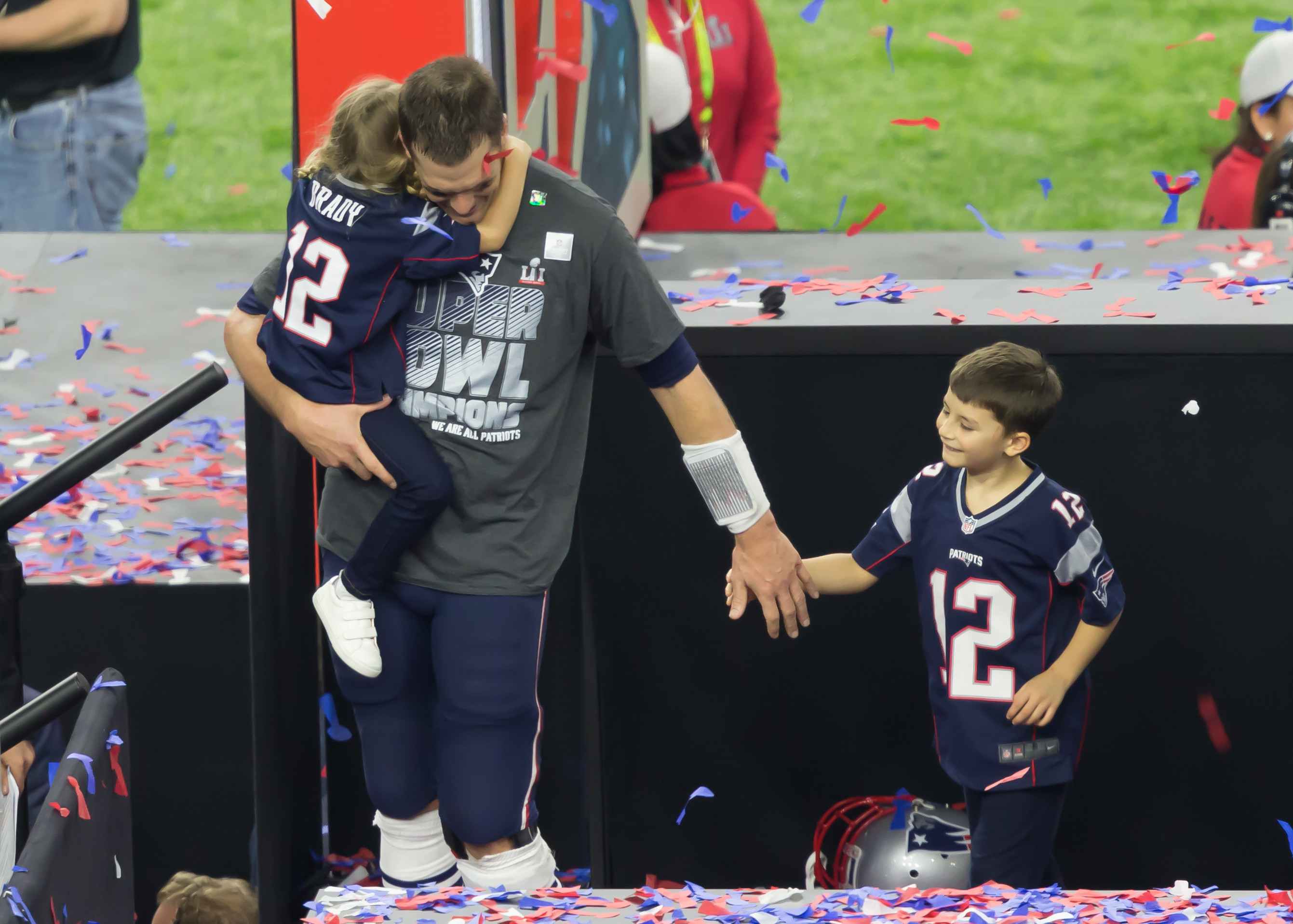Tom Brady celebrating with his kids after a Super Bowl