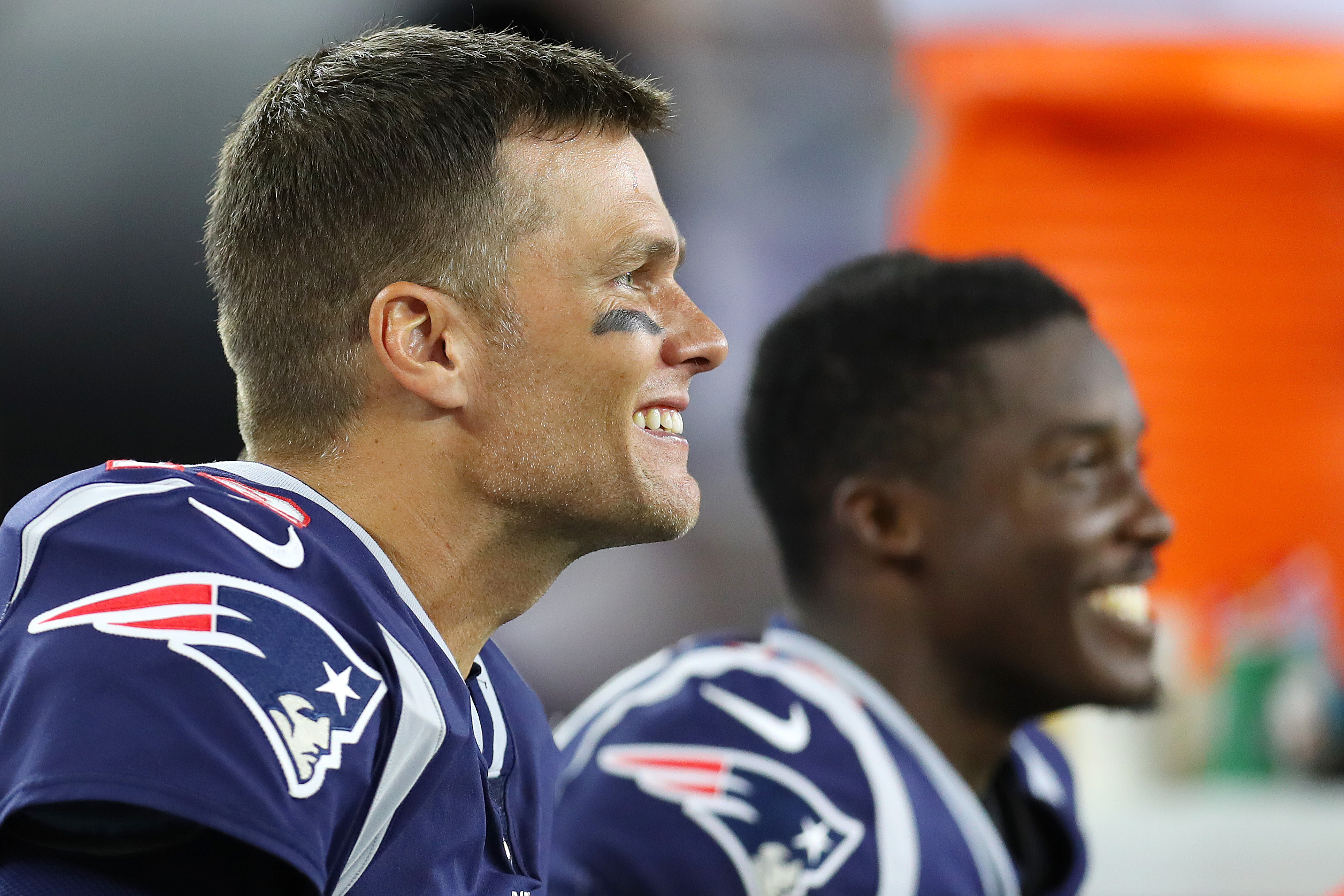 Tom Brady of the New England Patriots laughs