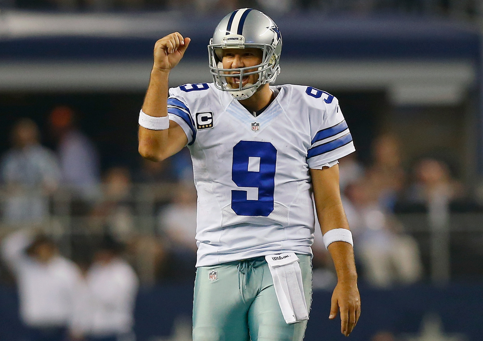 Tony Romo celebrates after a Cowboys play