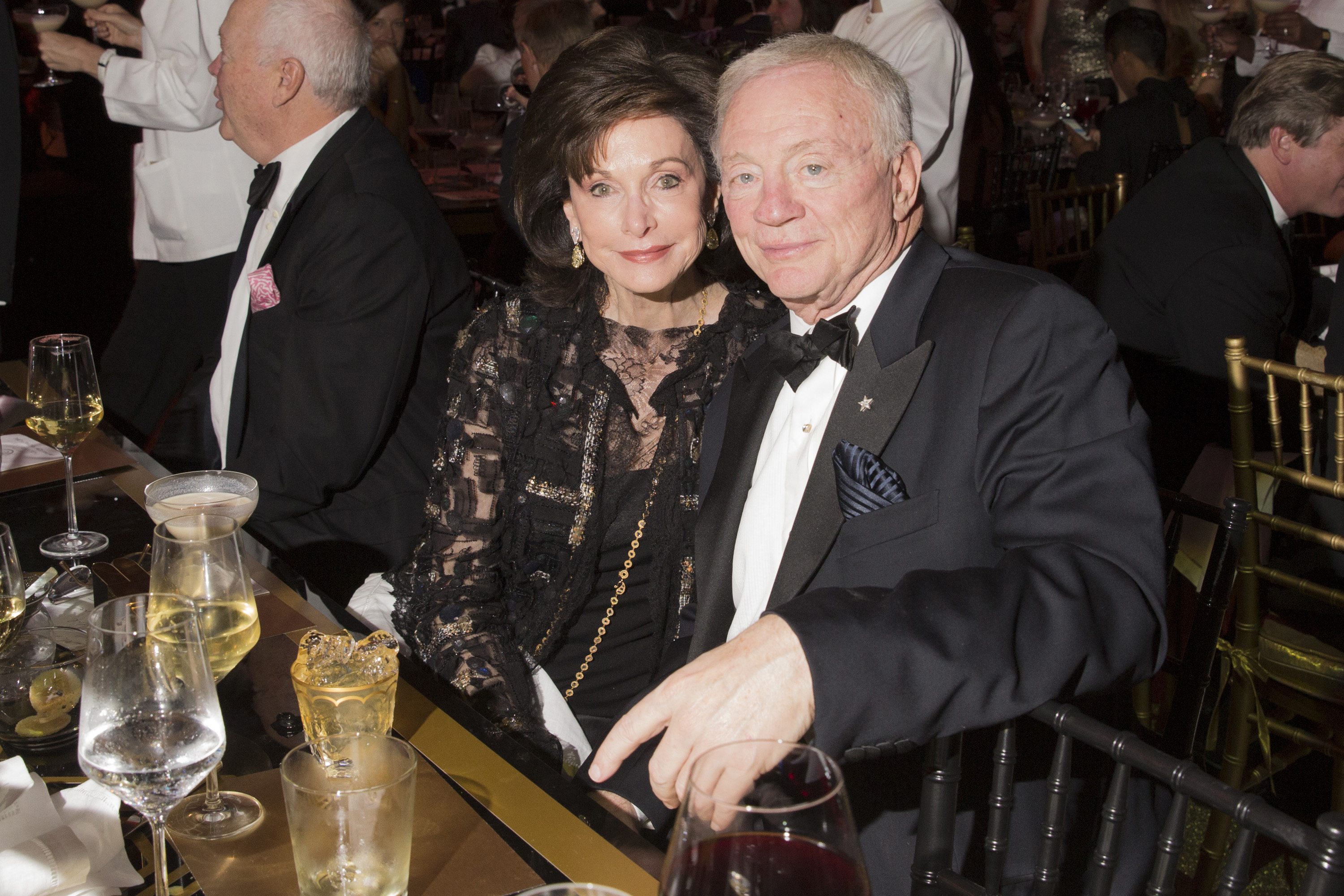 Gene Jones and Jerry Jones attend an art gala in 2014