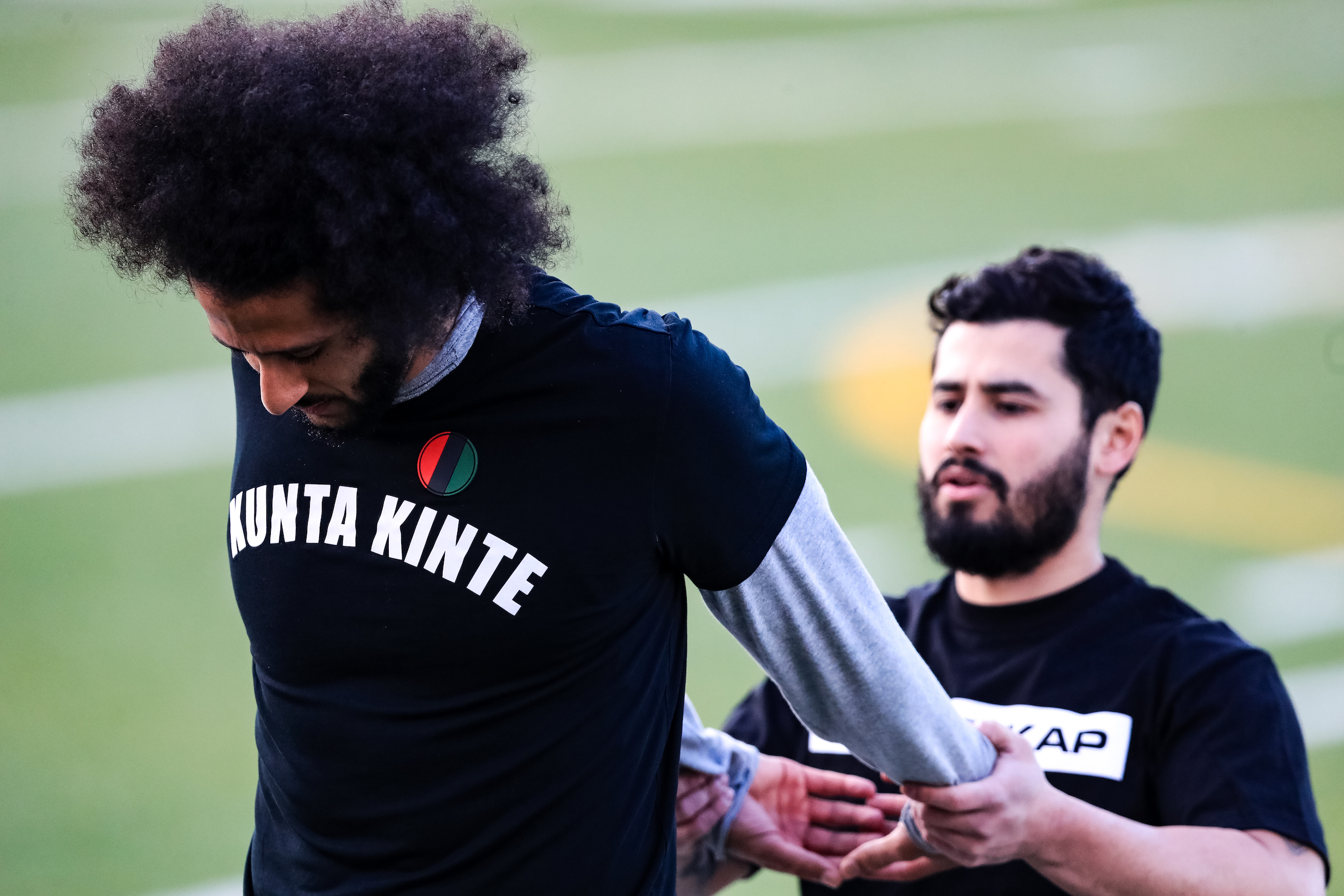 Colin Kaepernick stretches during his NFL workout held at Charles R Drew high school
