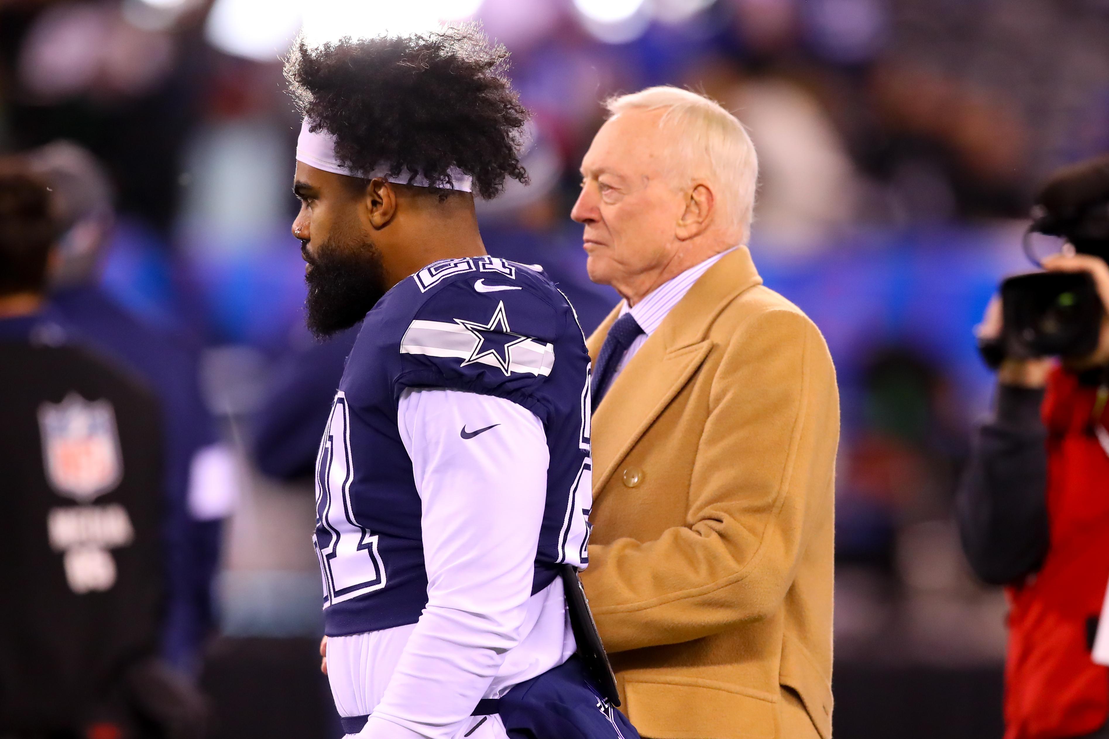 Cowboys Owner Jerry Jones talks with running back Ezekiel Elliott