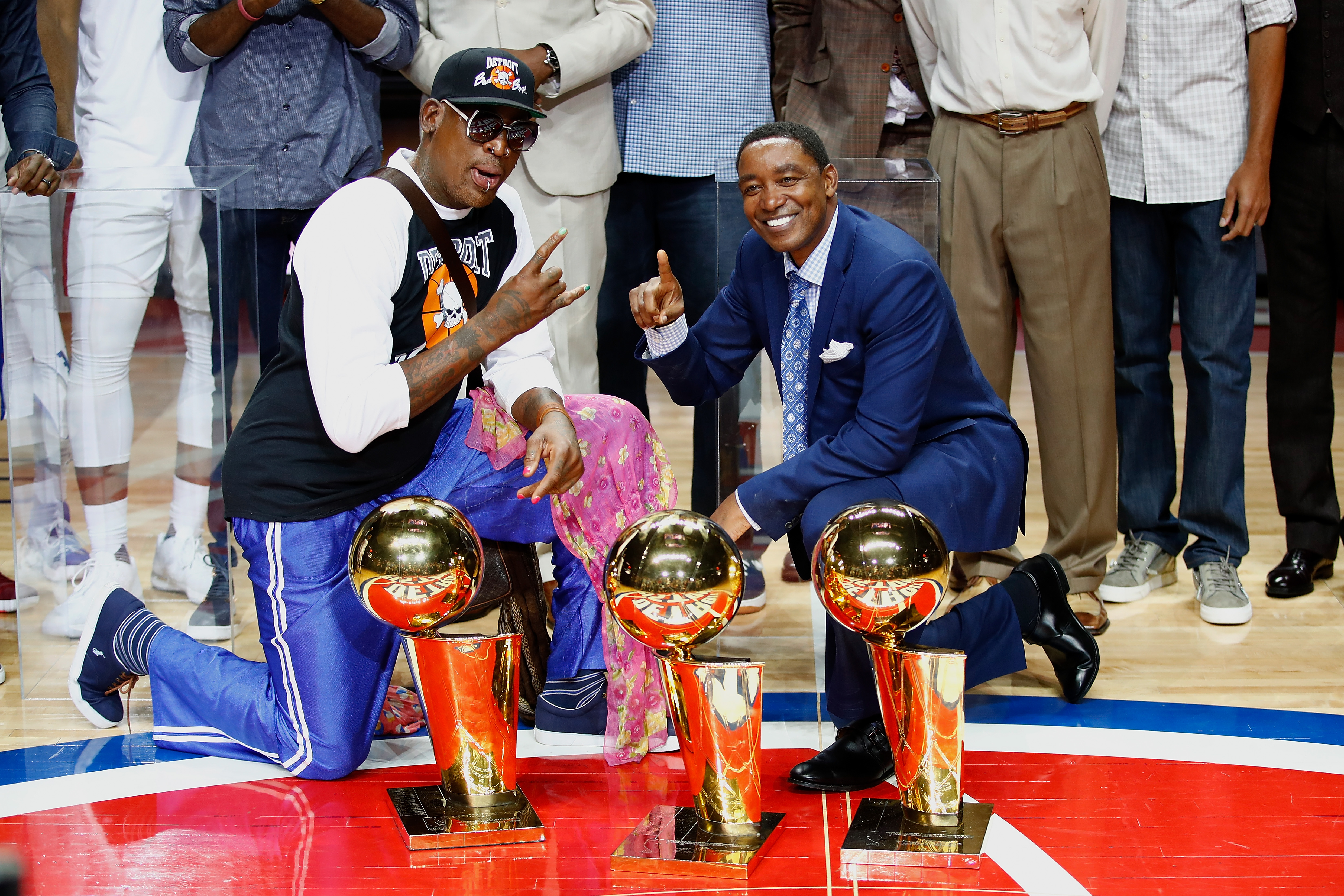 Former Detroit Pistons Isiah Thomas and Dennis Rodman pose with NBA trophies