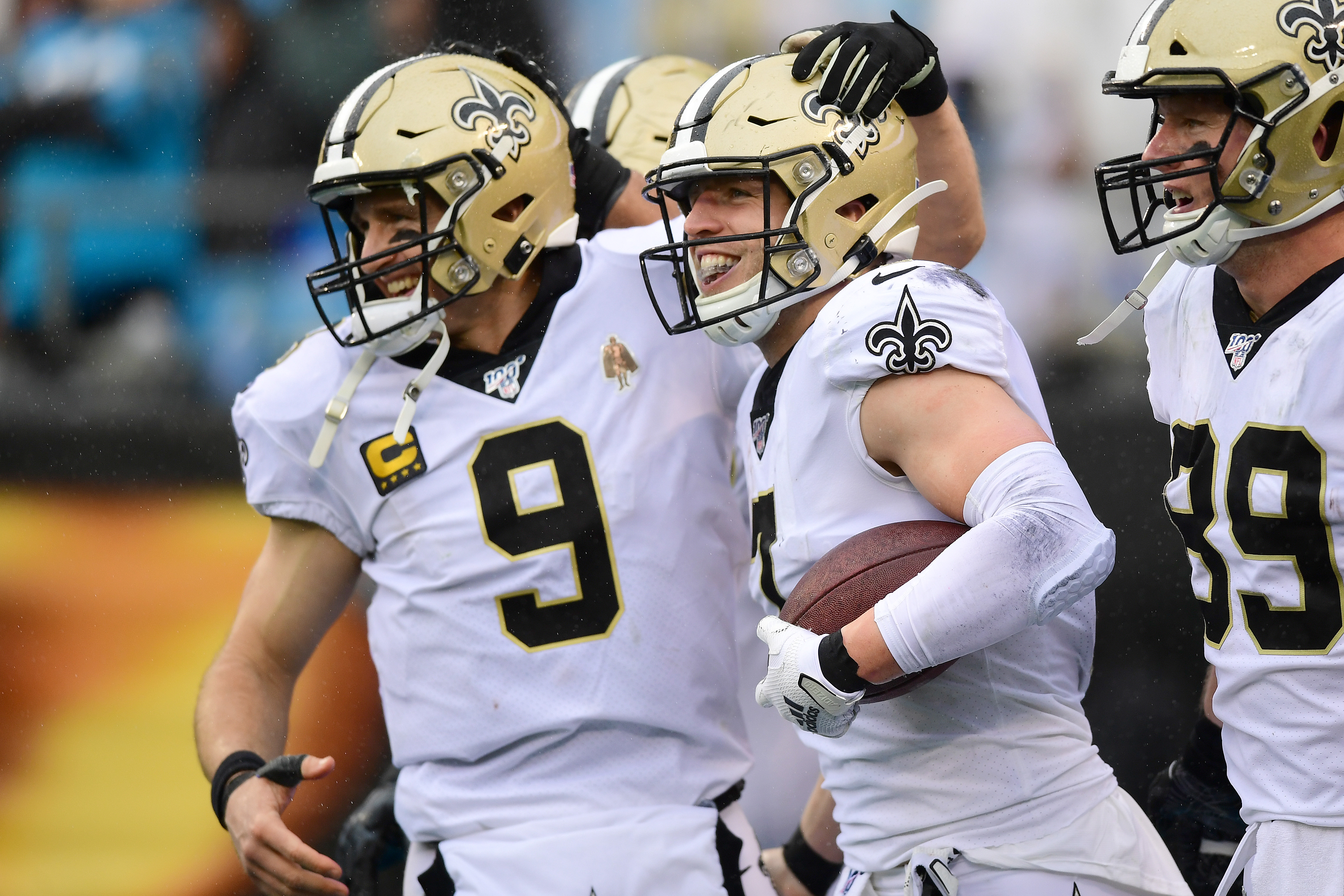Drew Brees and Taysom Hill of the New Orleans Saints celebrate a touchdown pass