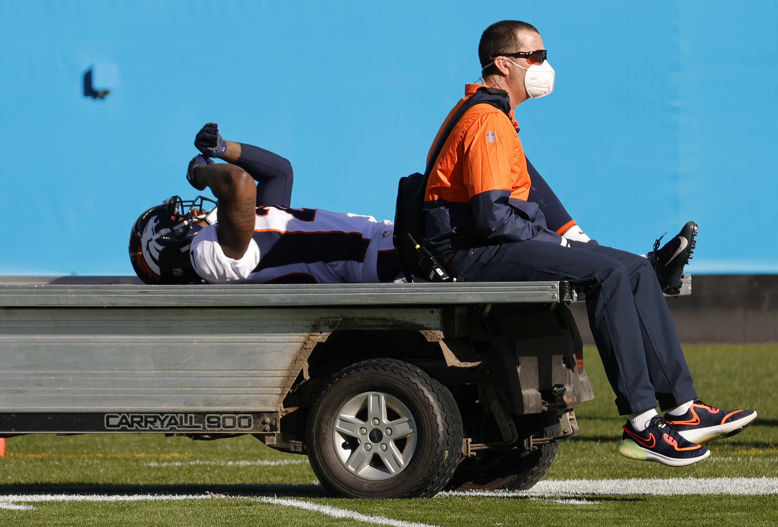 Duke Dawson Jr. of the Denver Broncos is carted off the field
