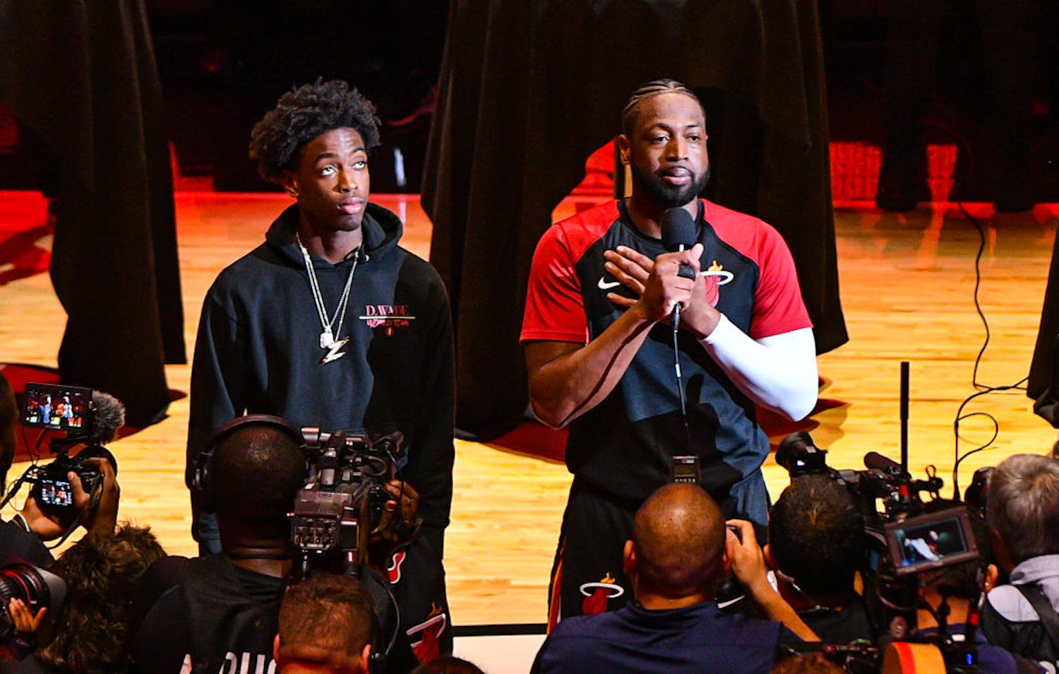 Dwyane Wade's teenage son Zaire is growing into a star basketball prospect, but he still gets humbled by his old man on the court.