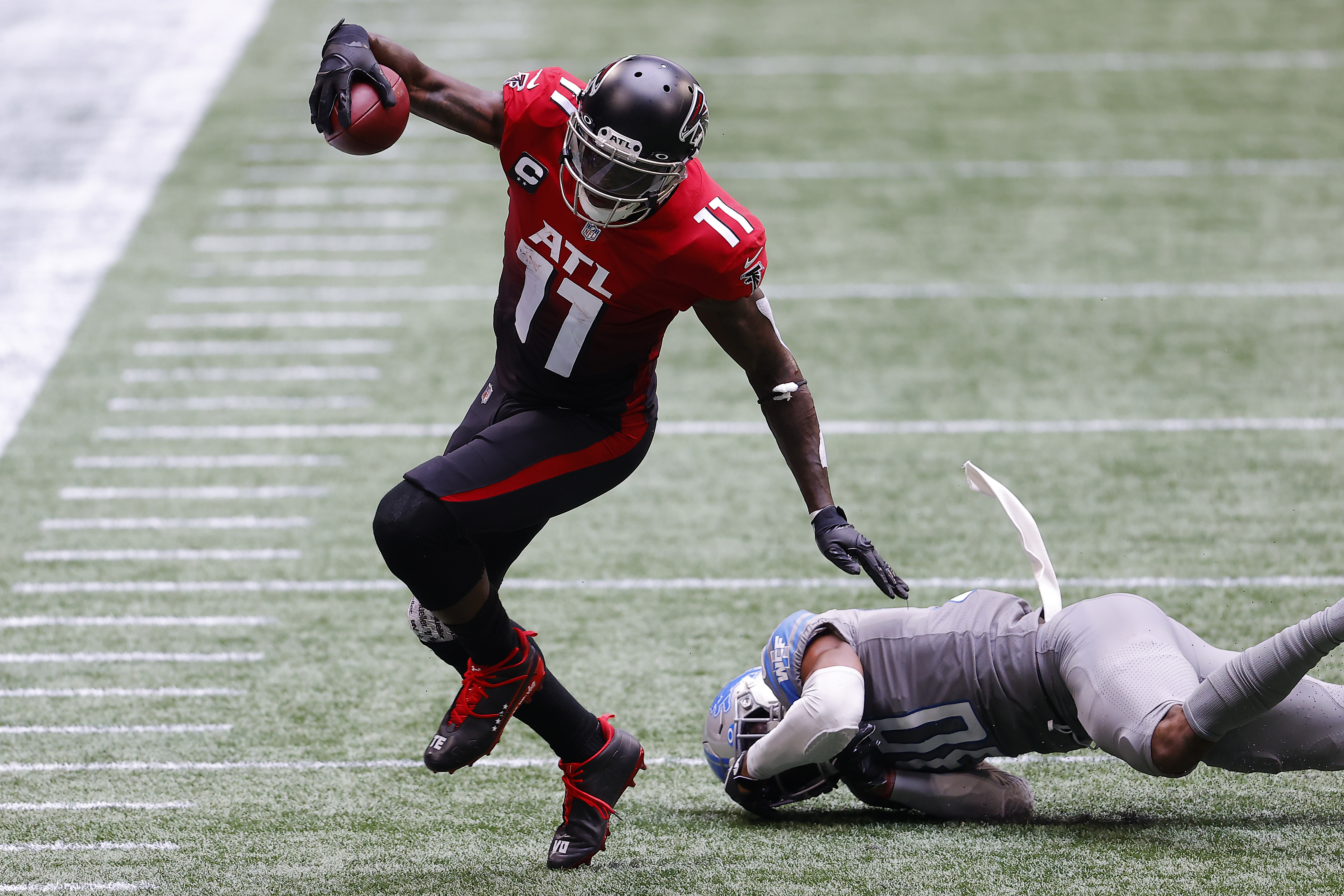 The Falcons' Julio Jones avoids a defender