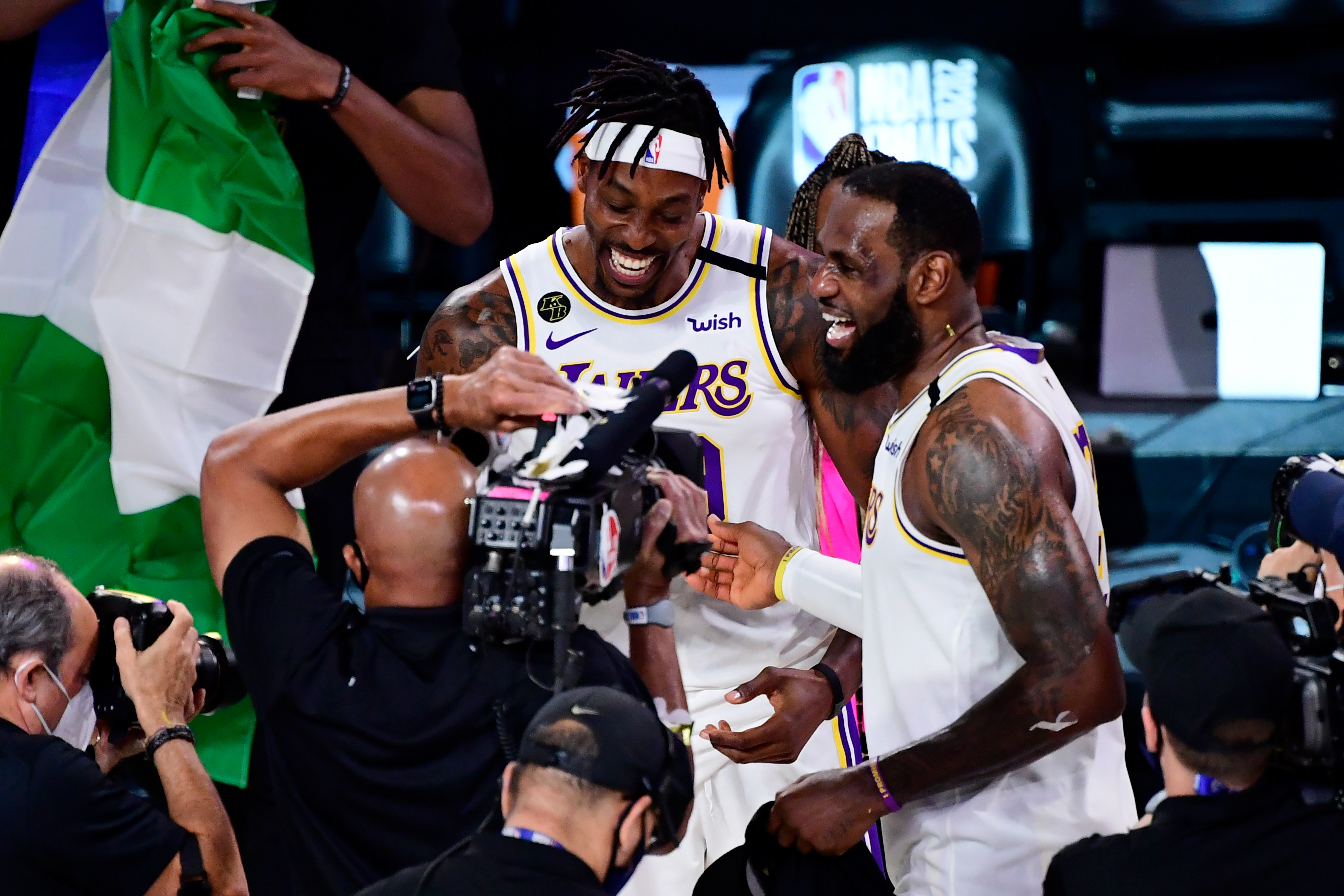 LeBron James of the Los Angeles Lakers celebrates with Dwight Howard