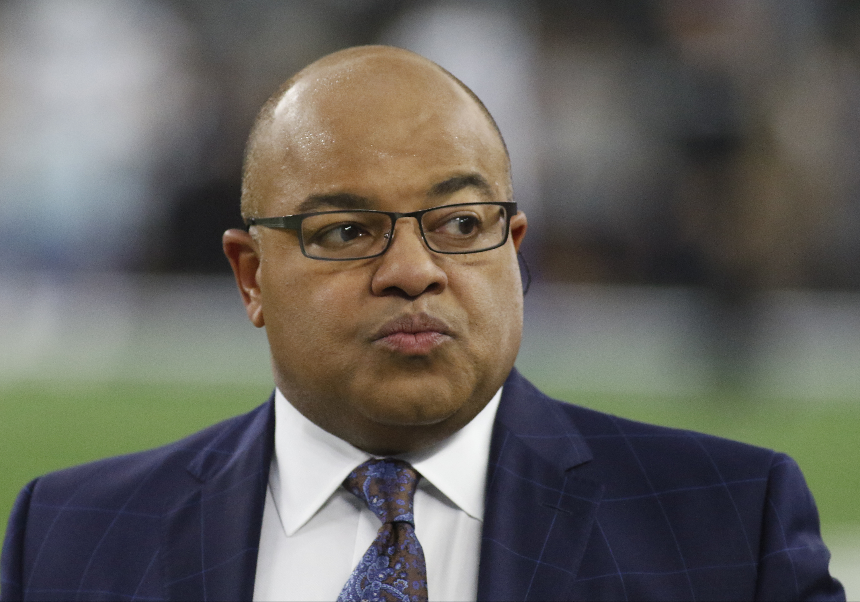 Veteran announcer Mike Tirico is calling 'Sunday Night Football' again in Week 14. Why is Tirico in the booth instead of Al Michaels?