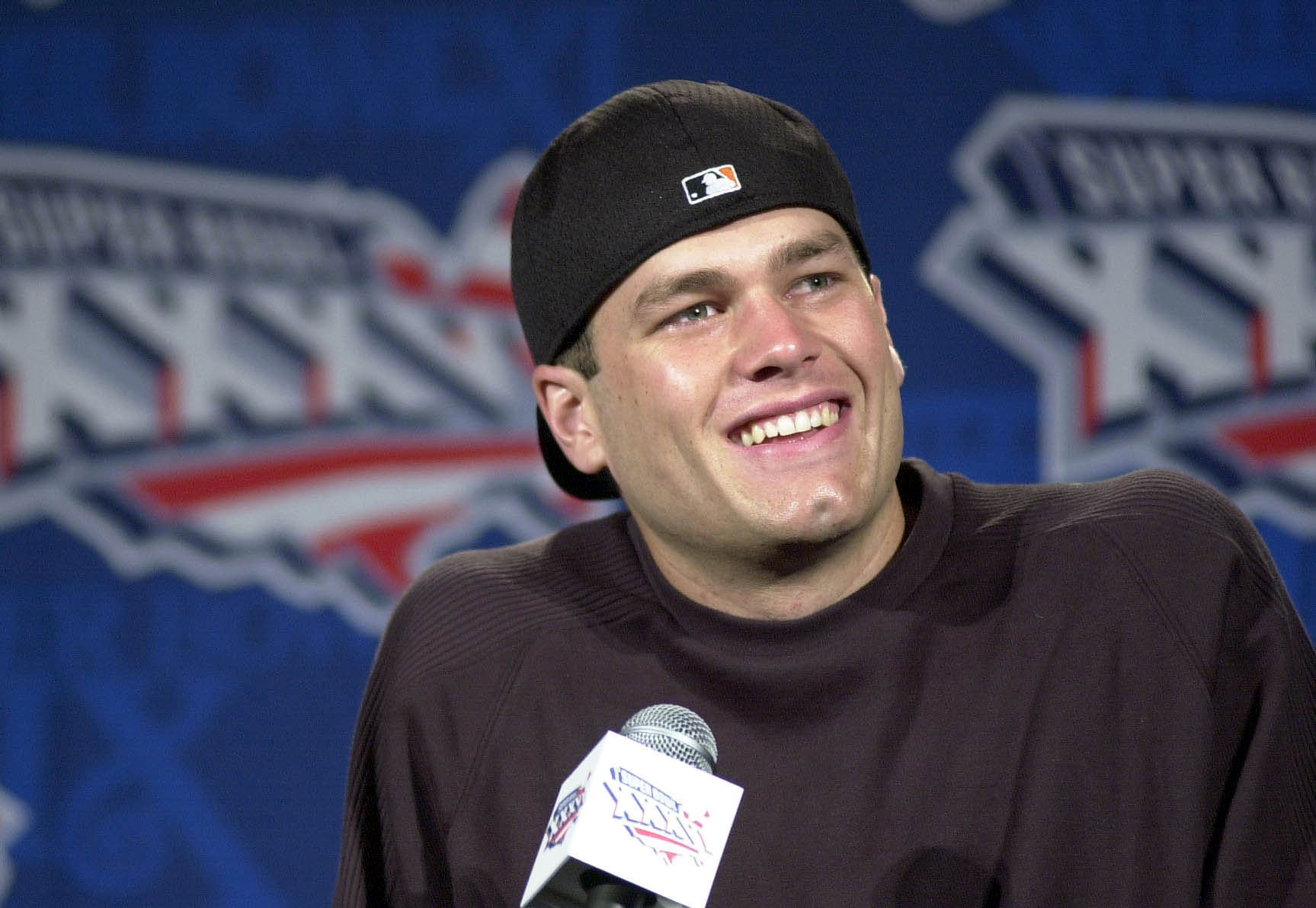 Tom Brady is all smiles at a 2001 press conference