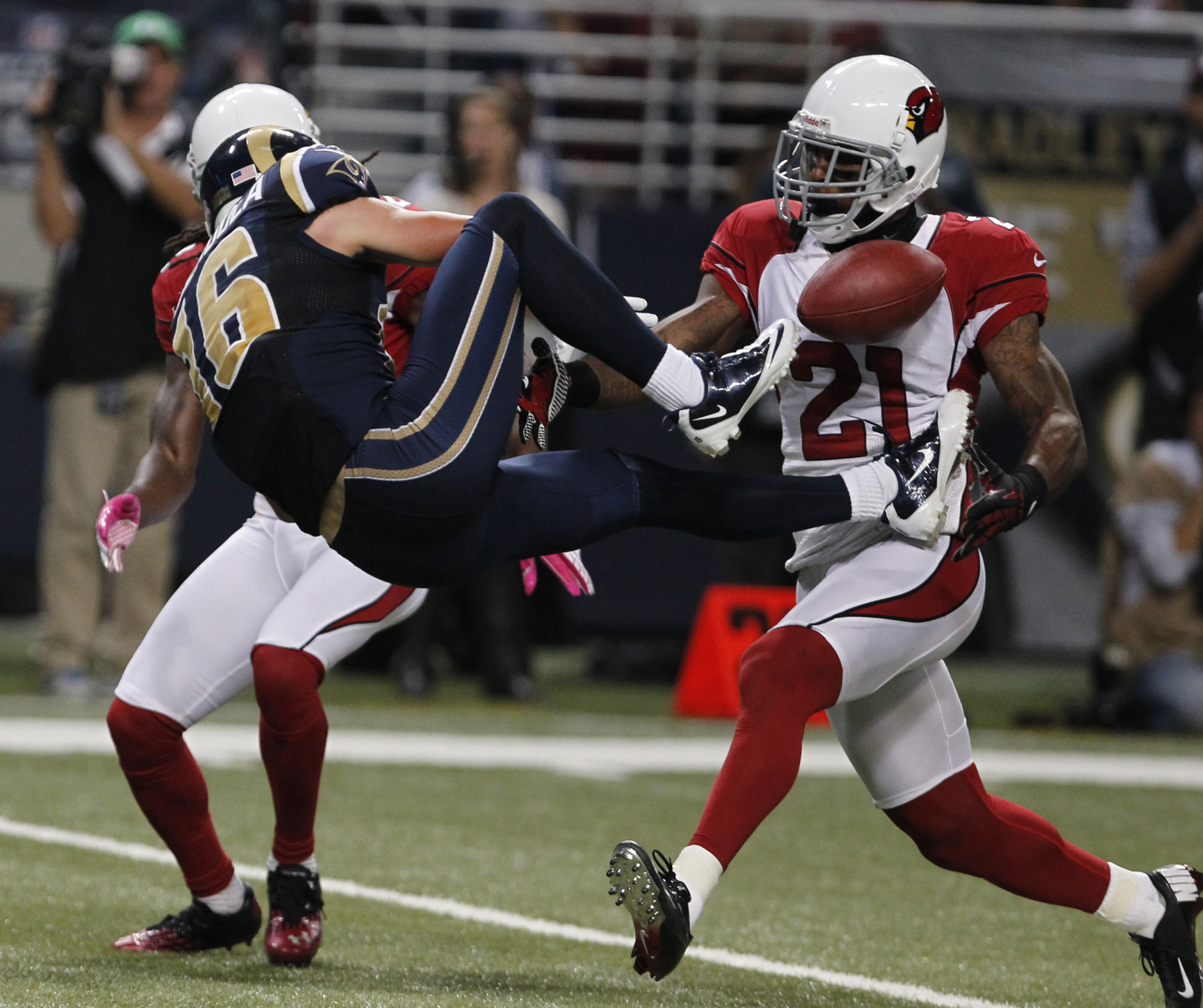 The Cardinals' Patrick Peterson breaks up a pass intended for the Rams' Danny Amendola