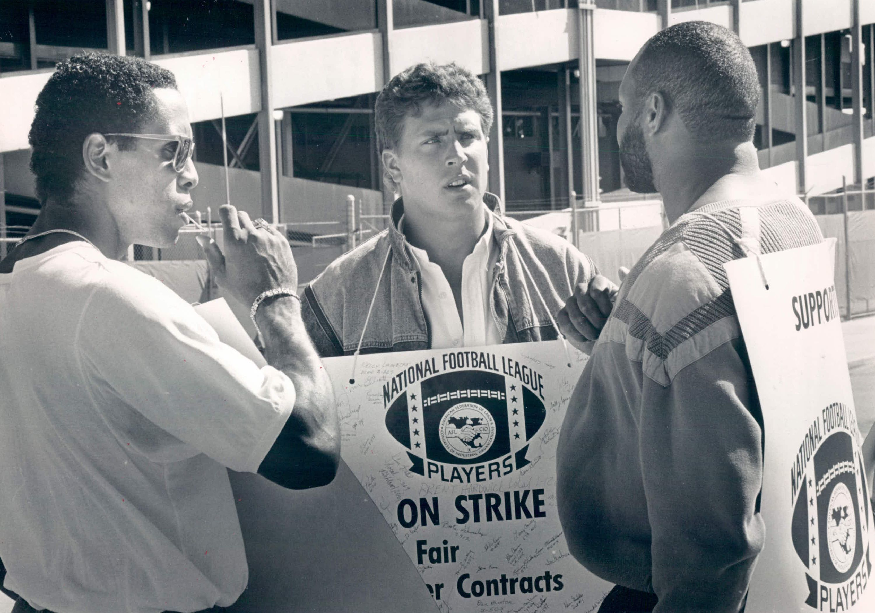 The 1987 NFL Strike at Mile Hi Stadium: Dan Merino (C) talks with Broncos players Dennis Smith (L) and Ricky Hunley of the NFLPA