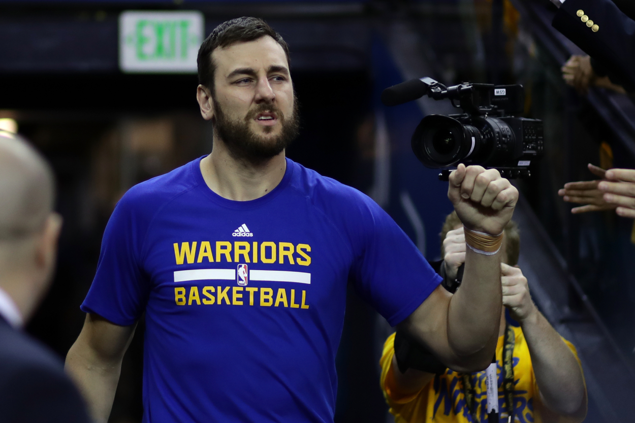 Andrew Bogut walks towards the court before a basketball game