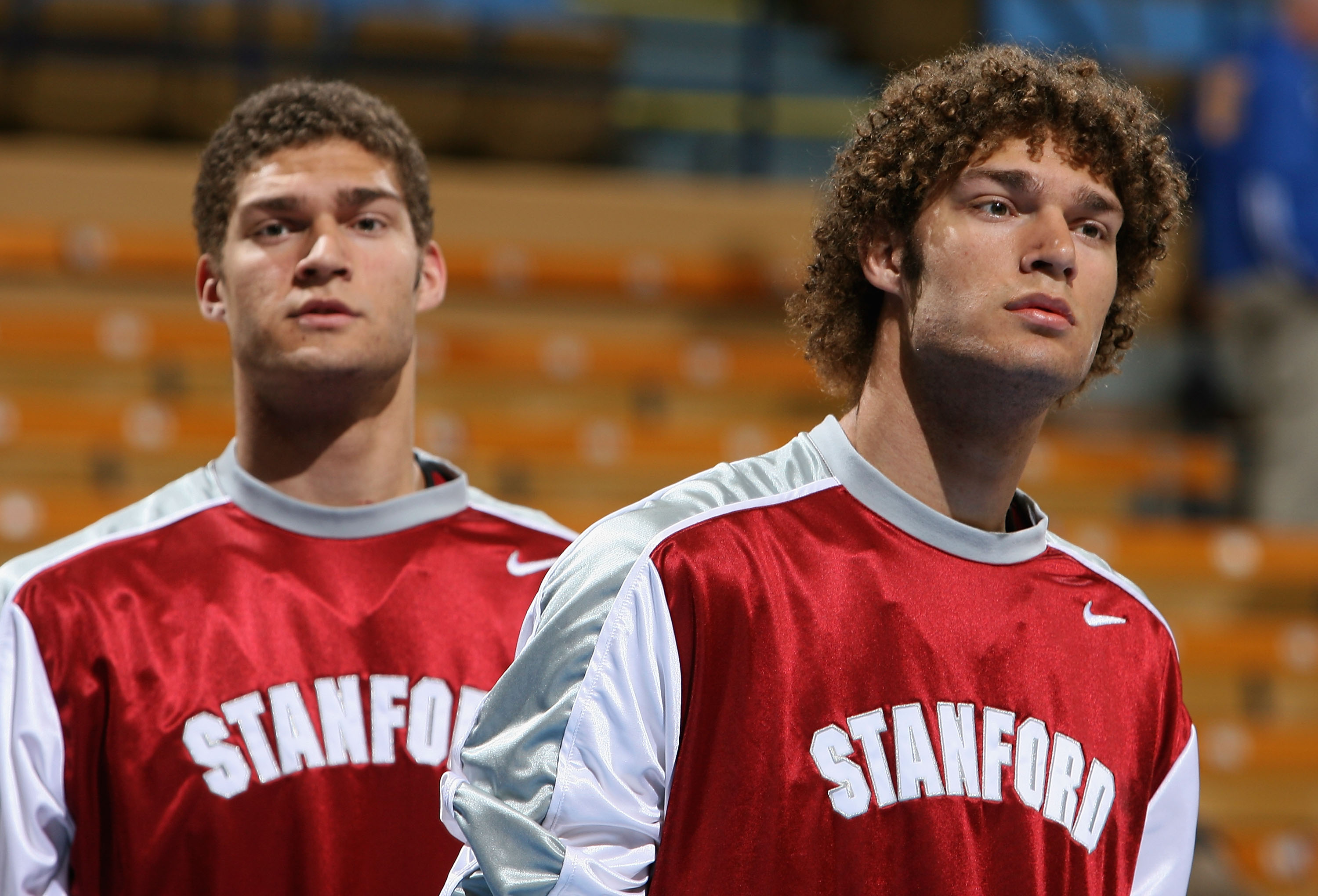 Brook and Robin Lopez look on before a basketbll game