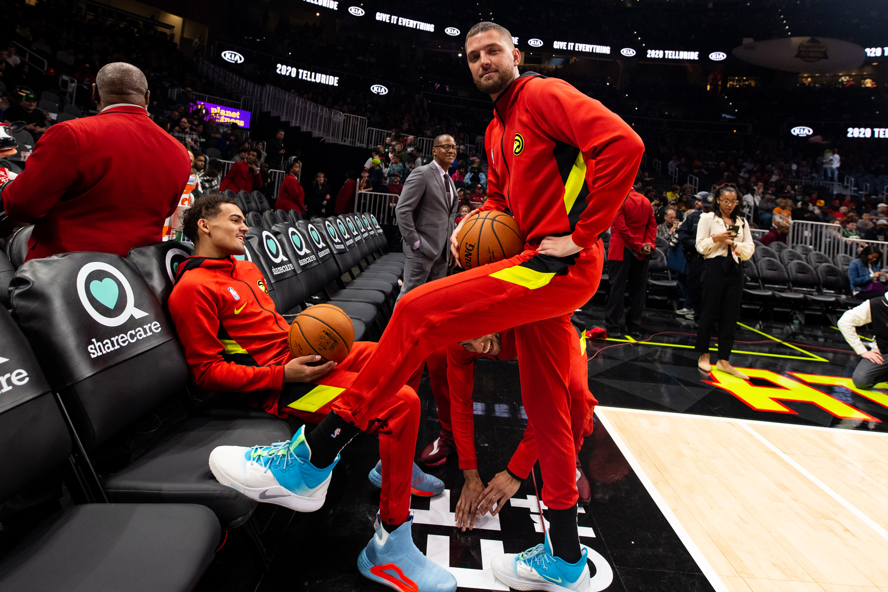 Trae Young and Chandler Parsons of the Atlanta Hawks looks on prior to a game